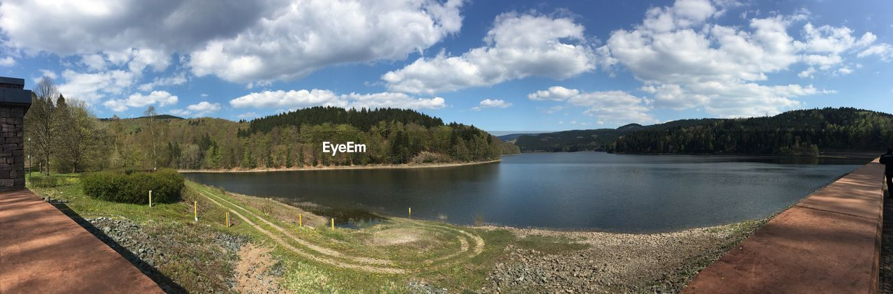 sky, nature, scenics, cloud - sky, water, river, tree, outdoors, no people, tranquility, beauty in nature, tranquil scene, holiday, landscape, day, panoramic, mountain, grass
