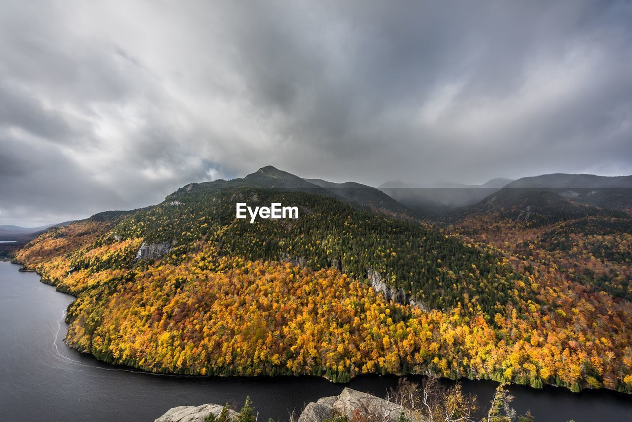 SCENIC VIEW OF YELLOW MOUNTAINS AGAINST SKY