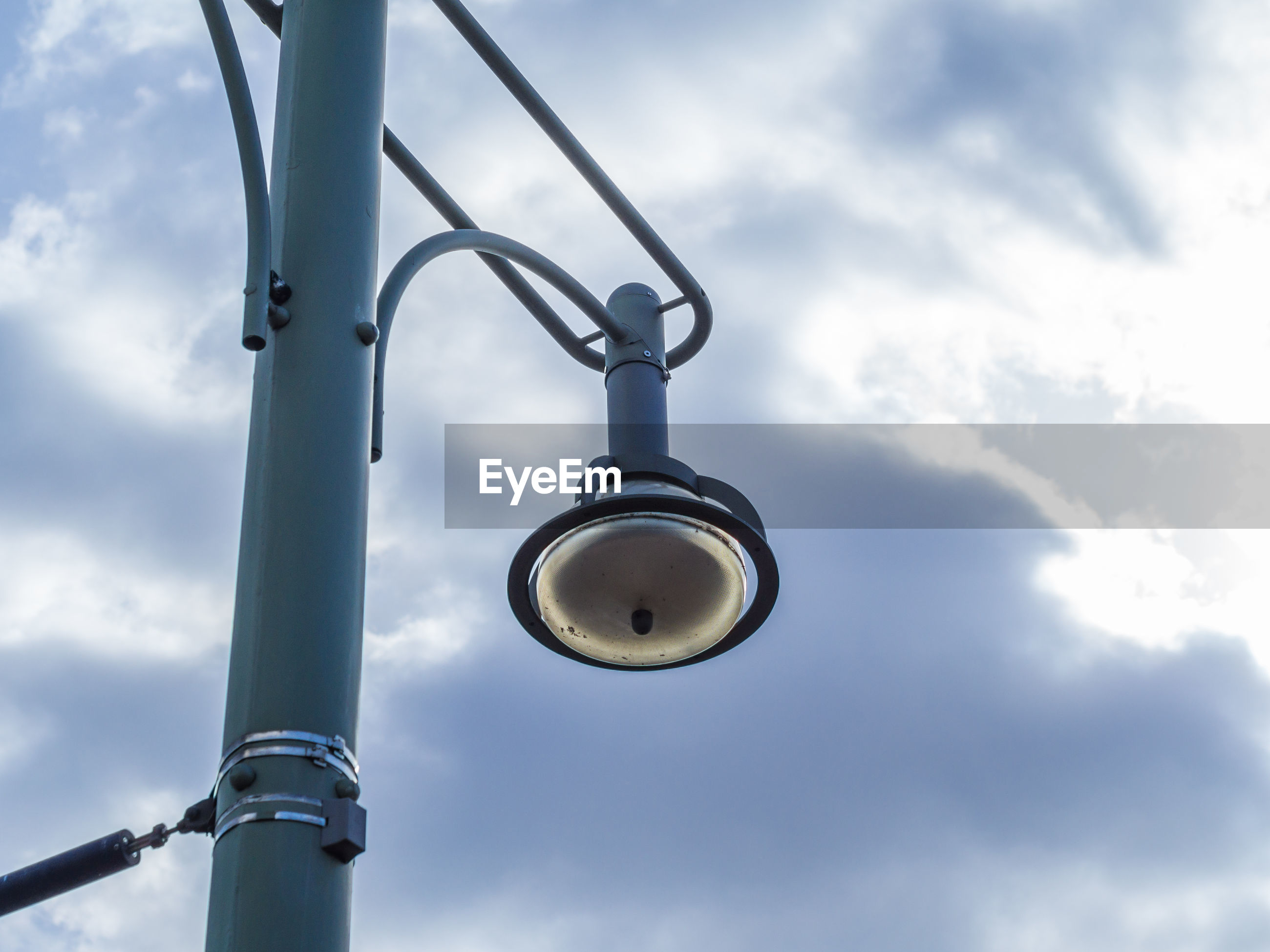Low angle view of street lamp against sky
