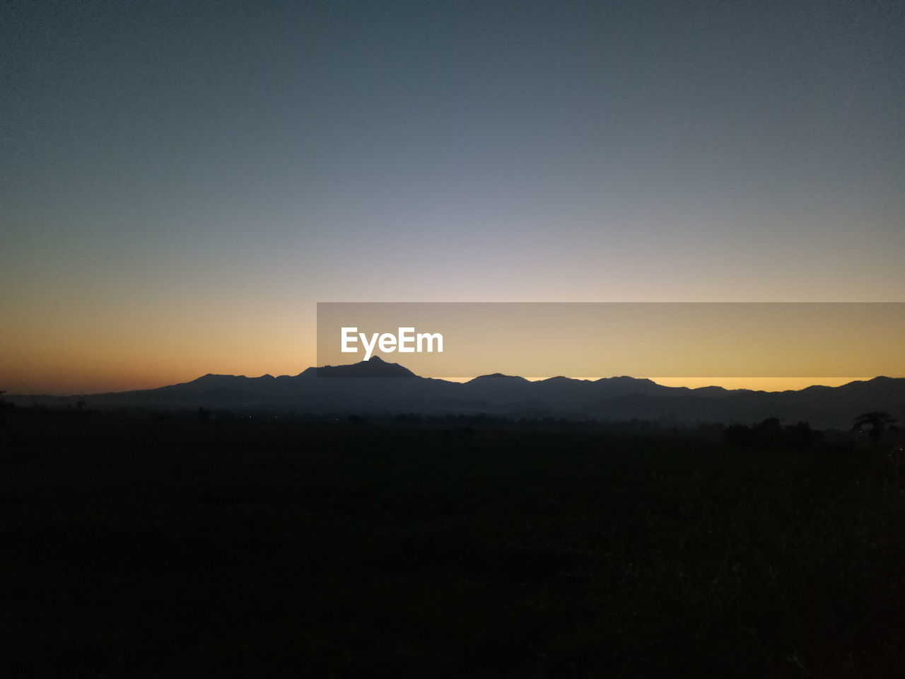 silhouette, sunset, nature, copy space, landscape, scenics, no people, tranquil scene, beauty in nature, clear sky, tranquility, outdoors, mountain, sky, day