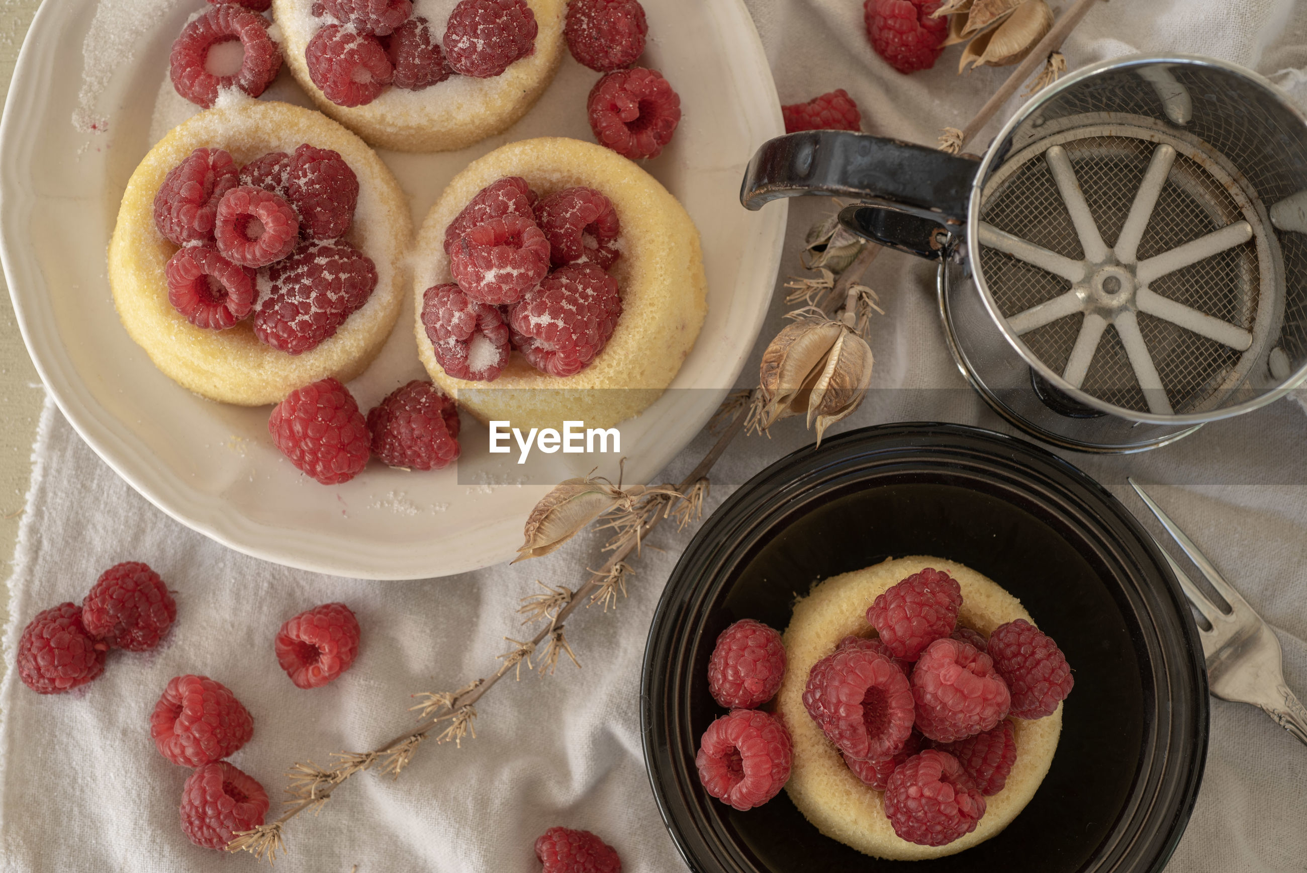 High angle view of berry fruit desert cakes on table