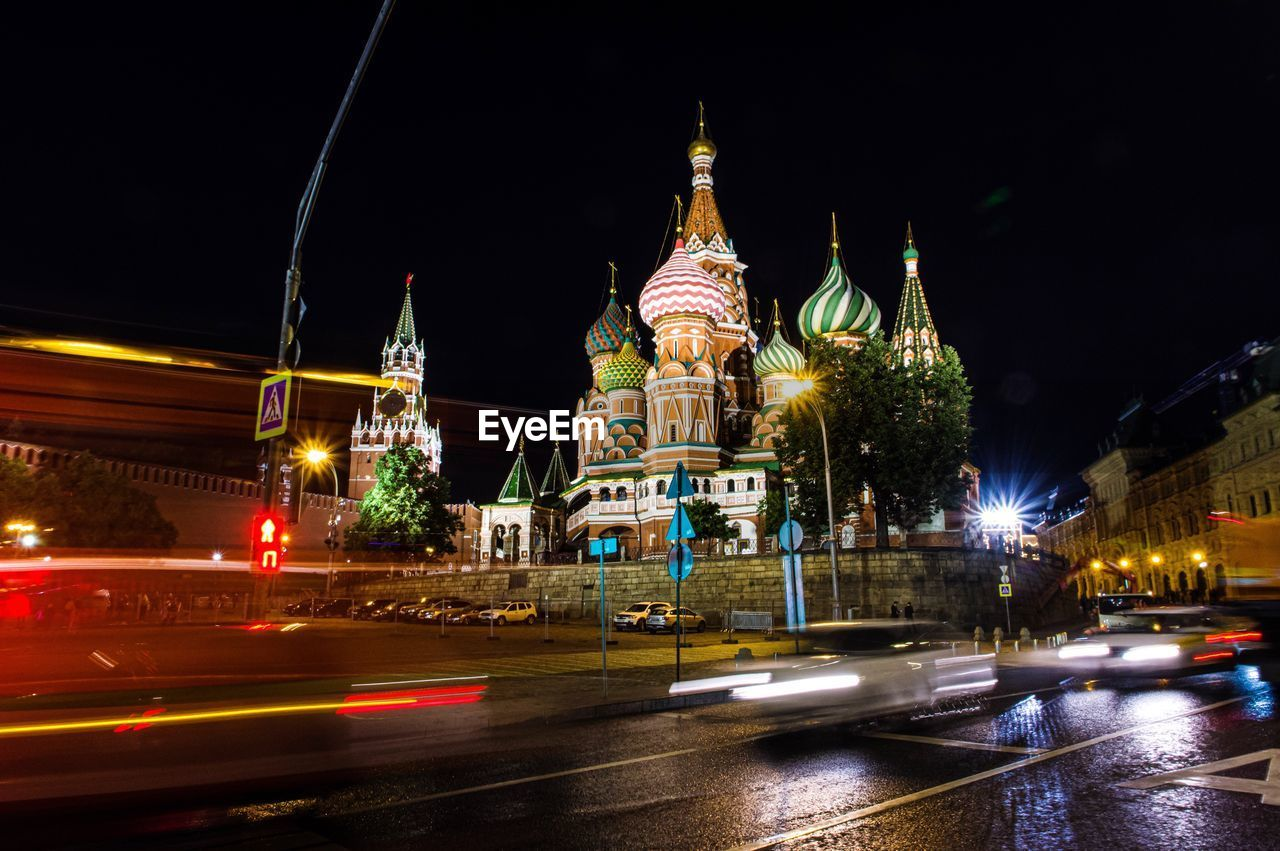 night, architecture, built structure, building exterior, illuminated, city, building, motion, light trail, transportation, religion, road, belief, long exposure, sky, place of worship, street, spirituality, blurred motion, speed, no people, outdoors, spire