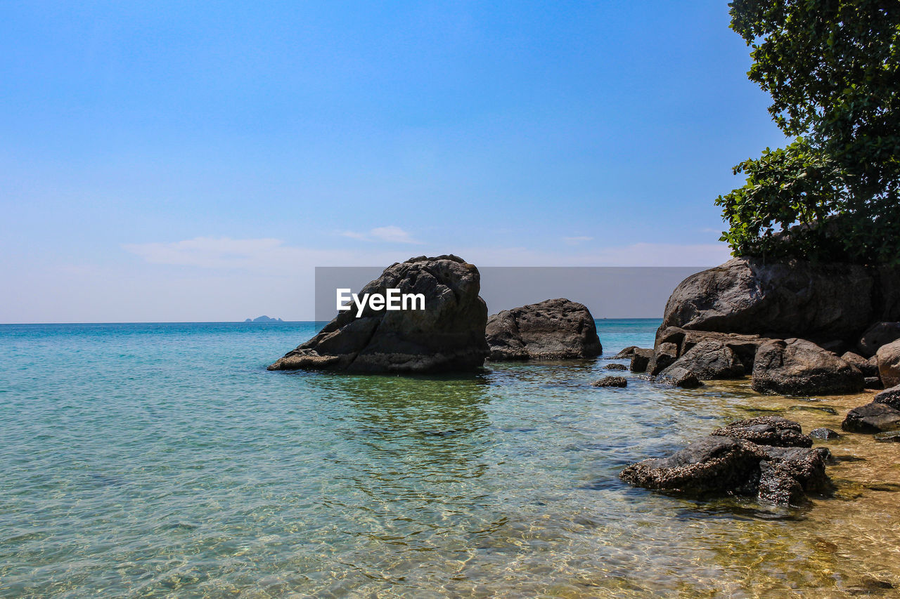 sea, nature, scenics, beauty in nature, tranquility, rock - object, tranquil scene, water, no people, outdoors, sky, day, horizon over water, blue