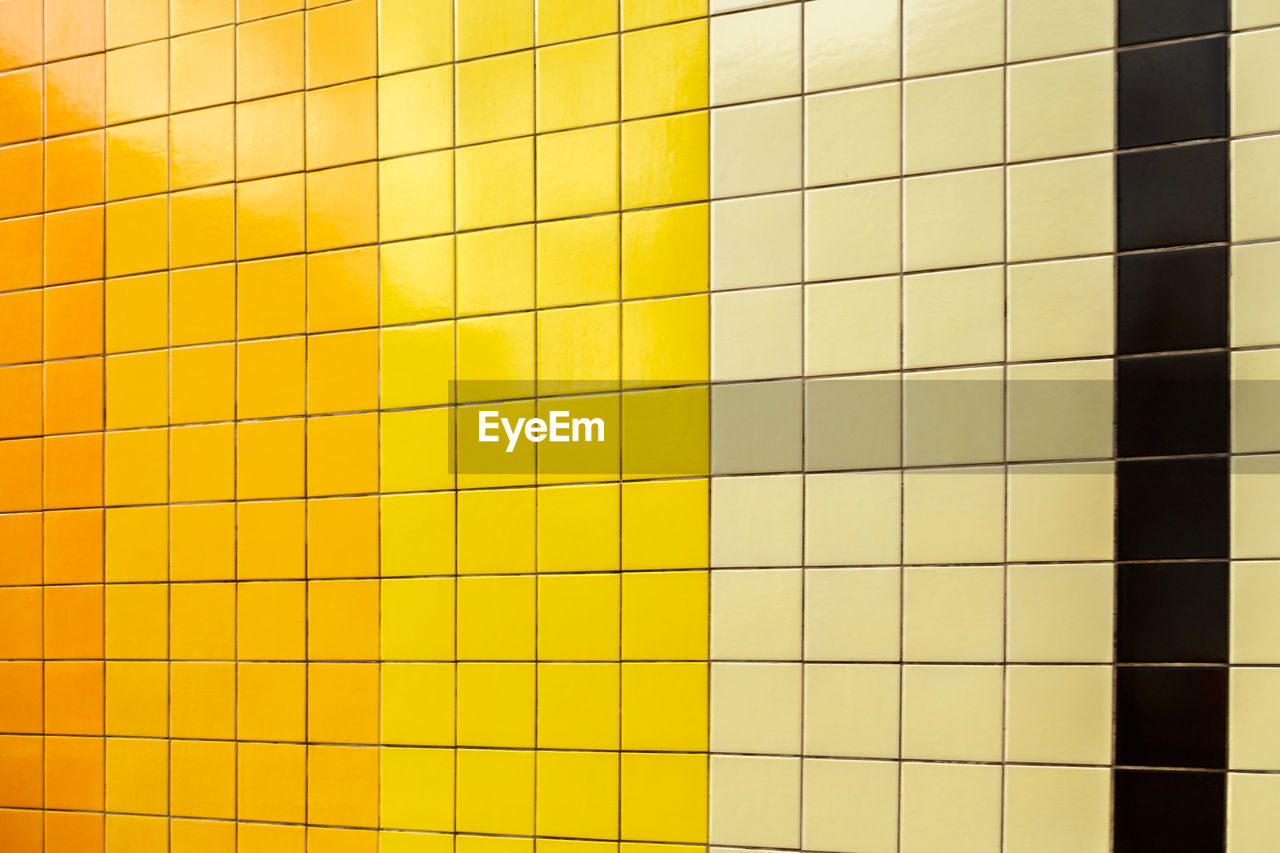 tile, backgrounds, full frame, yellow, wall - building feature, pattern, flooring, no people, square shape, built structure, architecture, shape, geometric shape, textured, indoors, multi colored, repetition, close-up, in a row, side by side, tiled floor