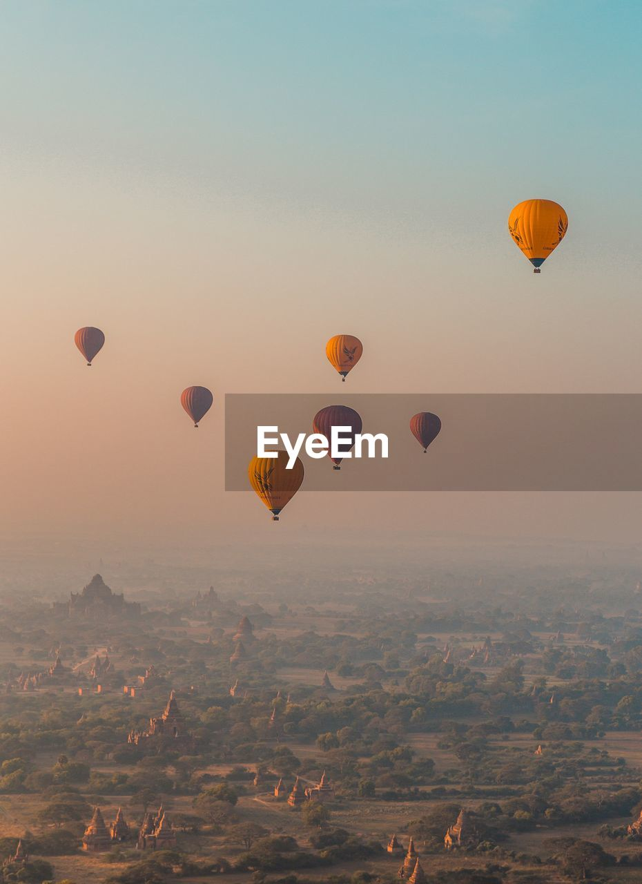 air vehicle, mid-air, sky, transportation, balloon, mode of transportation, flying, environment, landscape, nature, adventure, hot air balloon, beauty in nature, sunset, scenics - nature, travel, ballooning festival, motion, no people, on the move, freedom, outdoors