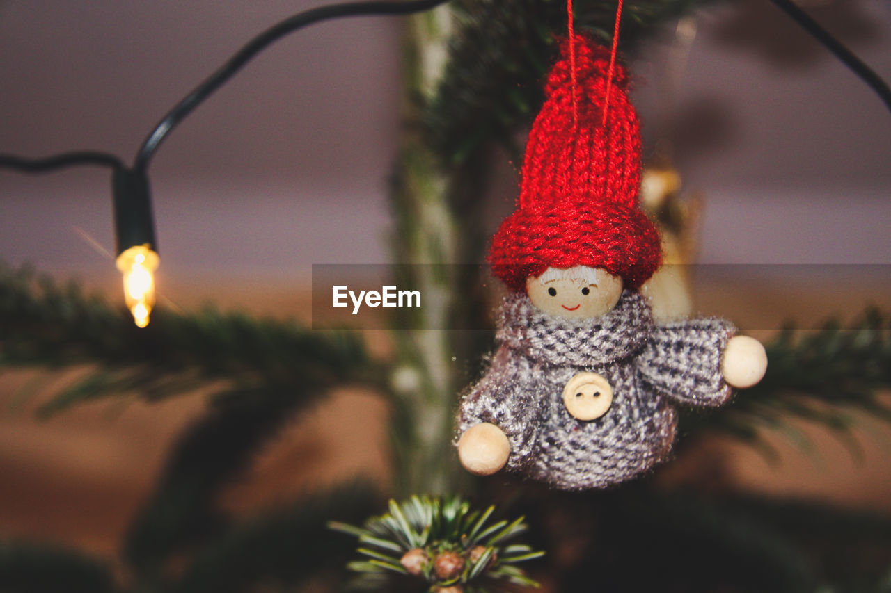 Close-Up Of Doll Hanging On Christmas Tree