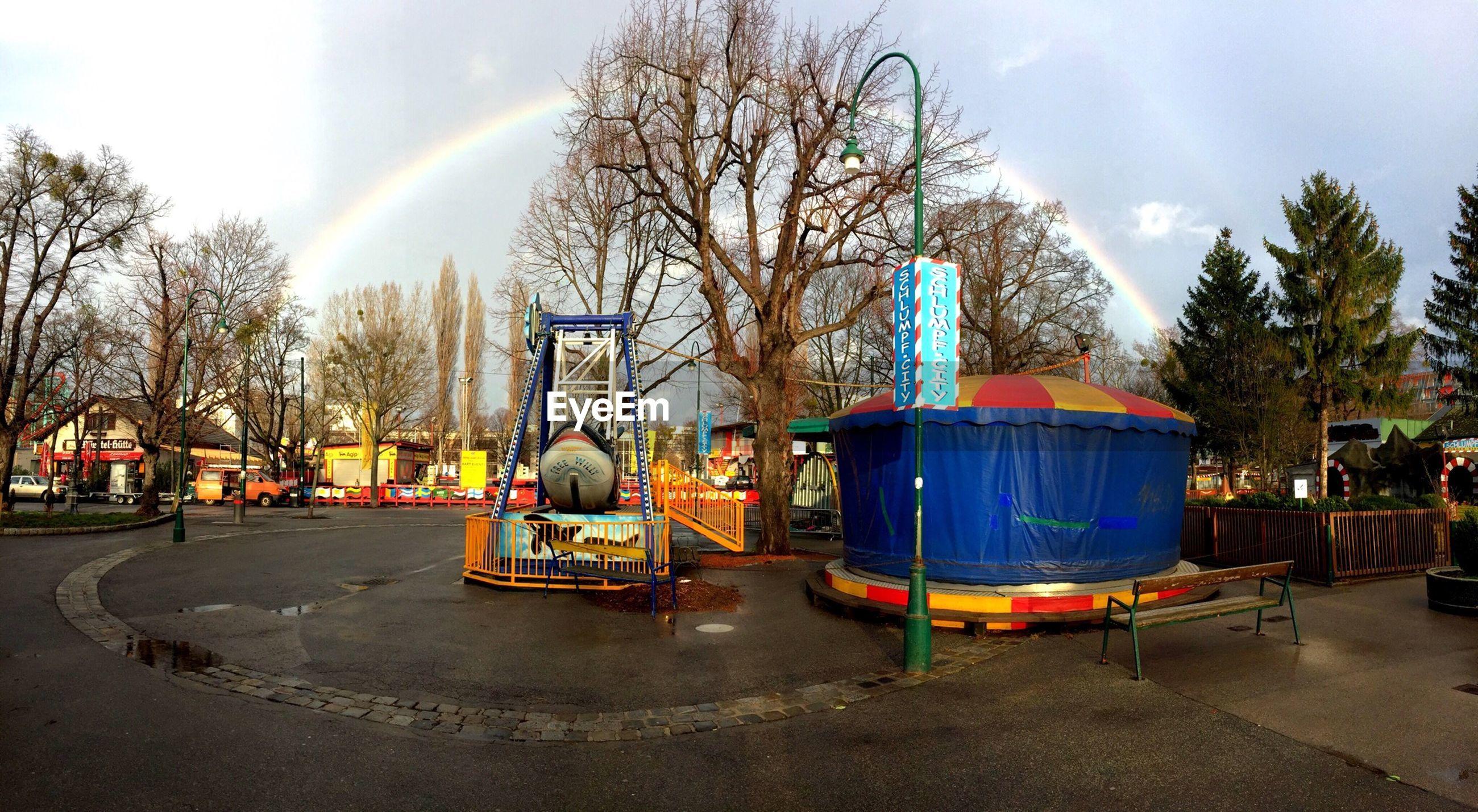 Amusement park rides at prater against sky