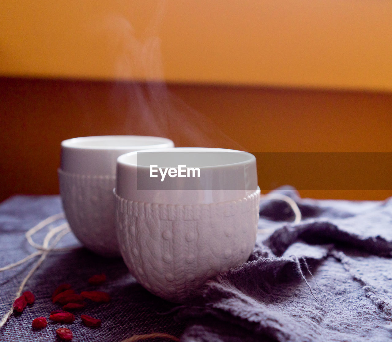 indoors, textile, still life, close-up, focus on foreground, no people, table, food and drink, drink, cup, bed, selective focus, wood - material, refreshment, wool, pattern, home interior, spool, orange color, furniture