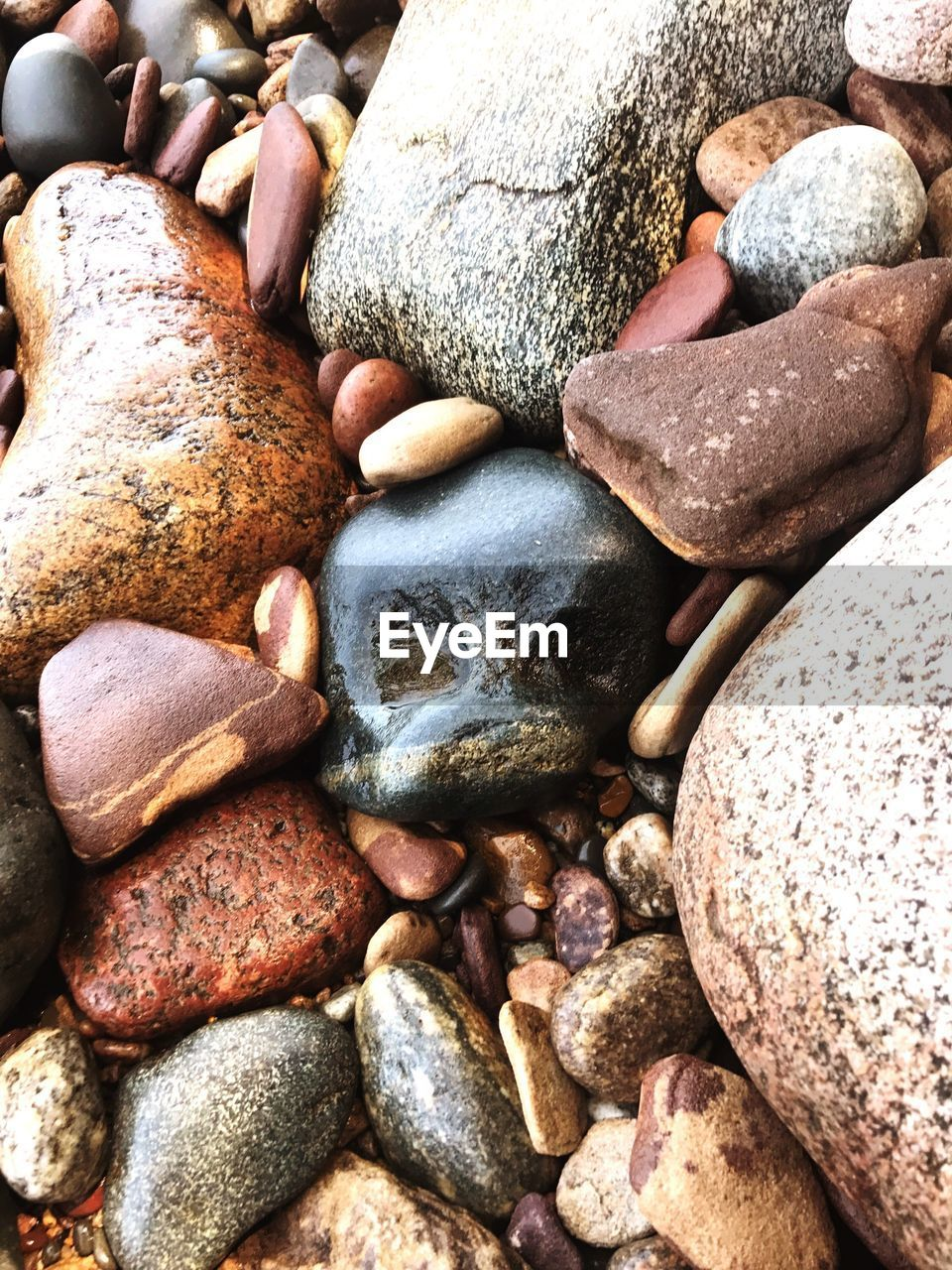 rock, solid, full frame, stone, rock - object, stone - object, large group of objects, pebble, backgrounds, no people, abundance, land, textured, close-up, nature, day, high angle view, variation, still life, beach