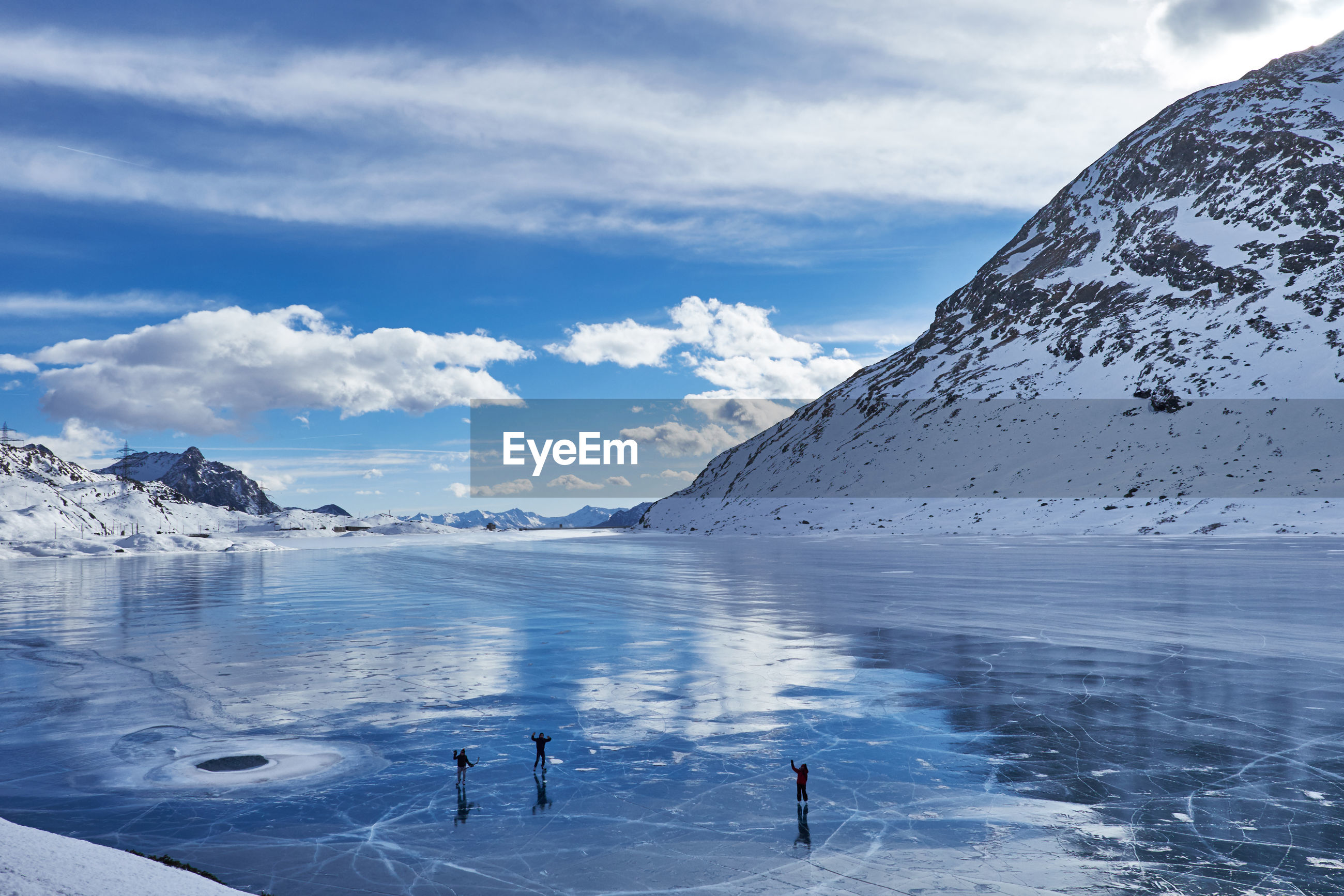 cold temperature, winter, cloud - sky, snow, nature, scenics, beauty in nature, frozen, sky, water, ice, sea, outdoors, idyllic, day, tranquil scene, landscape, mountain, glacier, people, one person, ice skate