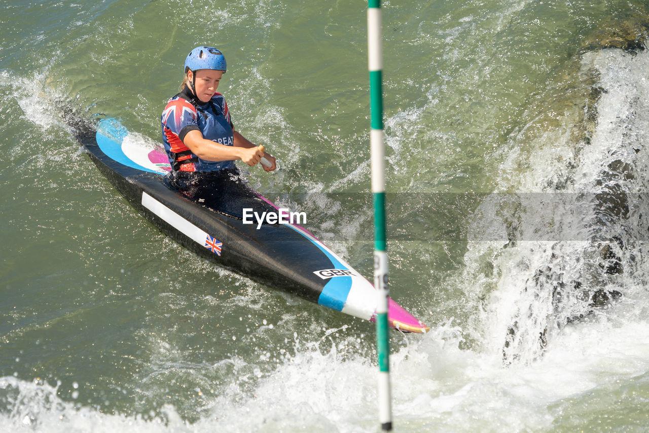 MAN WITH UMBRELLA ON BOAT