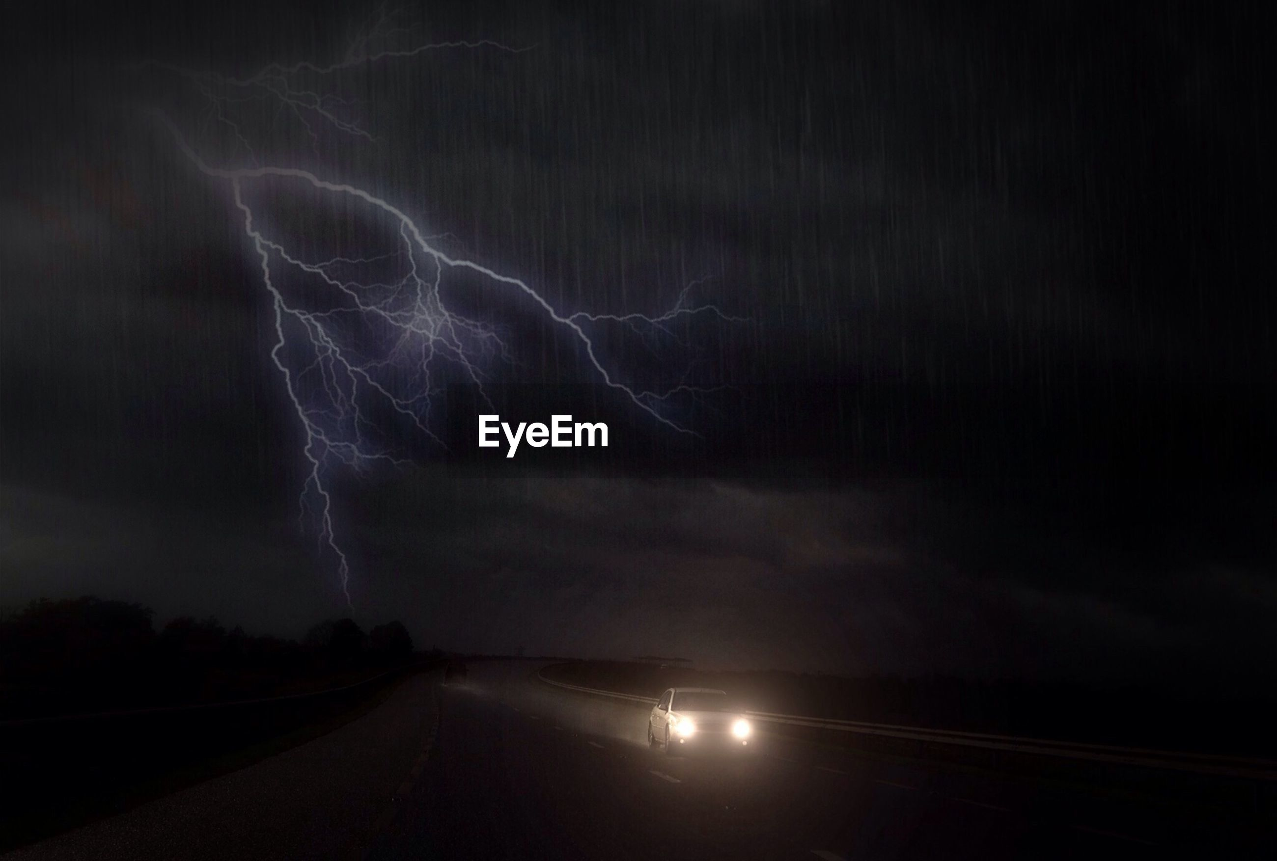 VIEW OF ROAD AT NIGHT