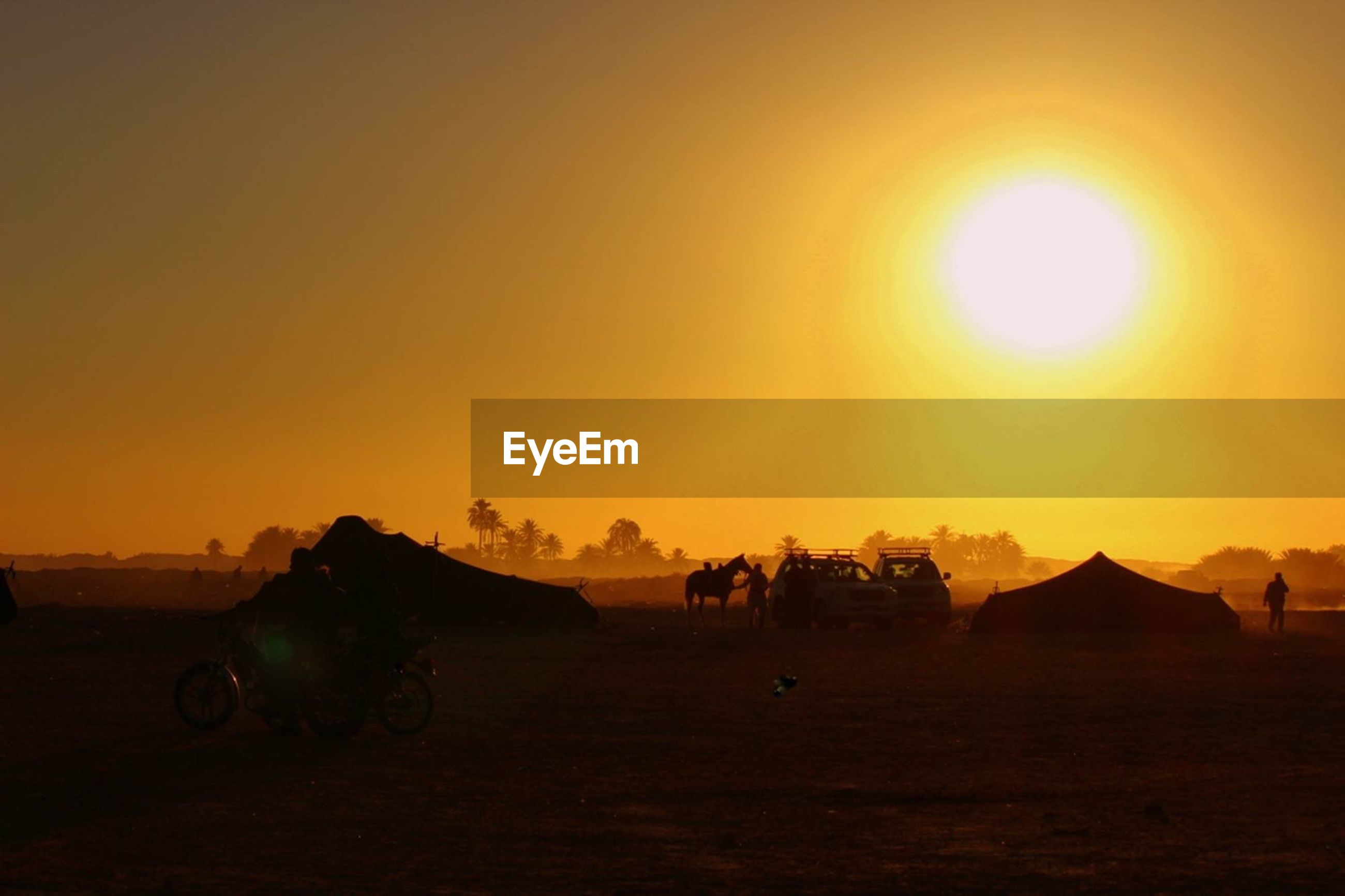 sunset, sun, orange color, transportation, mode of transport, land vehicle, lens flare, copy space, bicycle, clear sky, sunlight, sunbeam, scenics, sky, beauty in nature, silhouette, tranquility, tranquil scene, travel