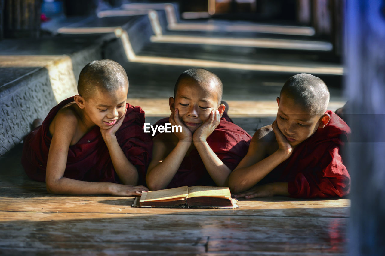 Monks reading book at temple