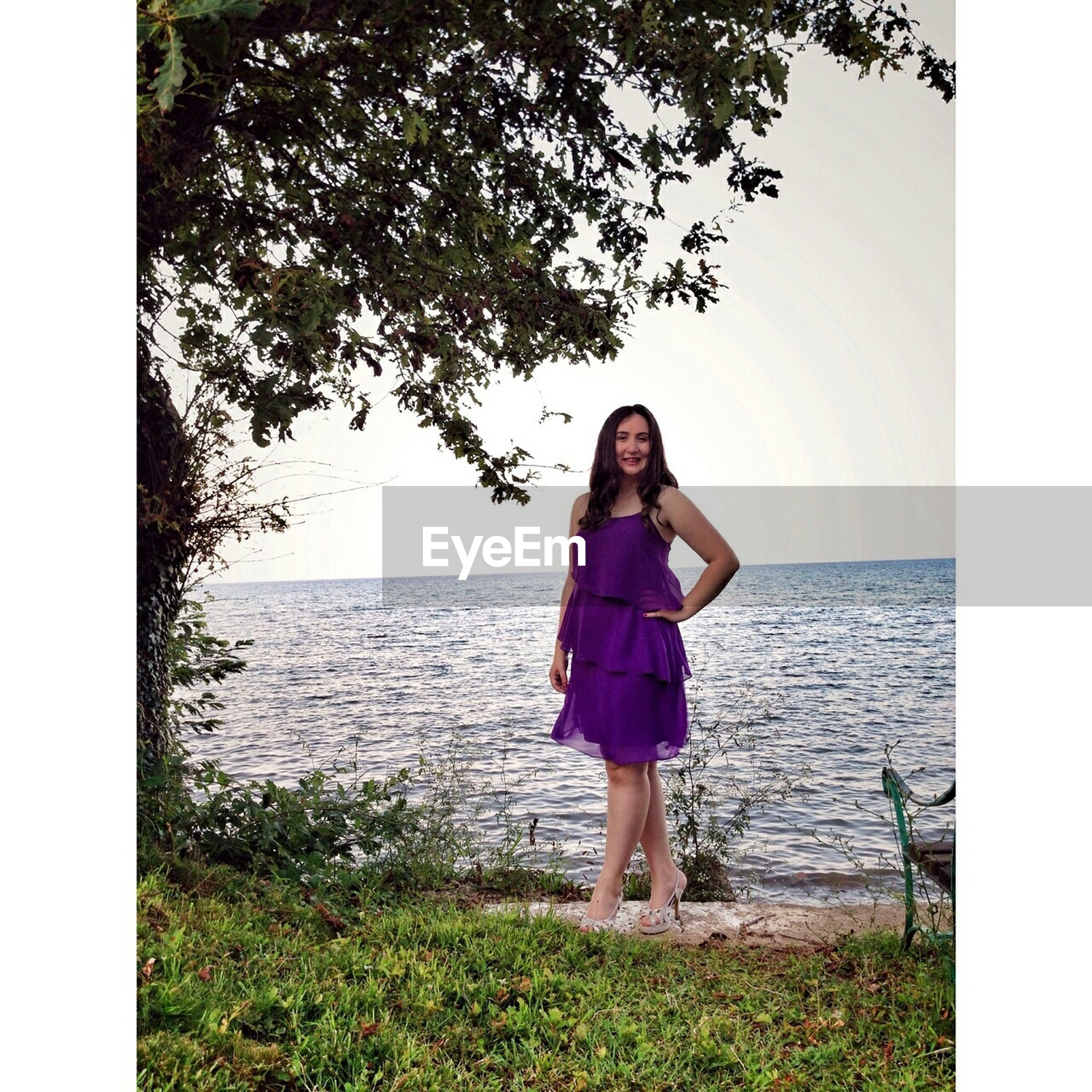 transfer print, water, auto post production filter, lifestyles, sea, leisure activity, full length, standing, horizon over water, casual clothing, nature, person, sky, tranquility, beauty in nature, scenics, young adult, tranquil scene