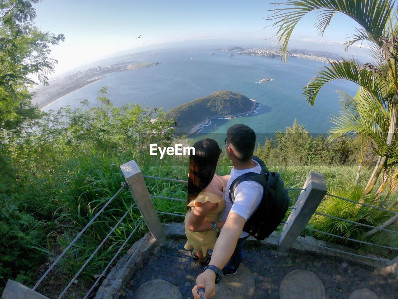 High angle view of couple embracing at observation point against sea