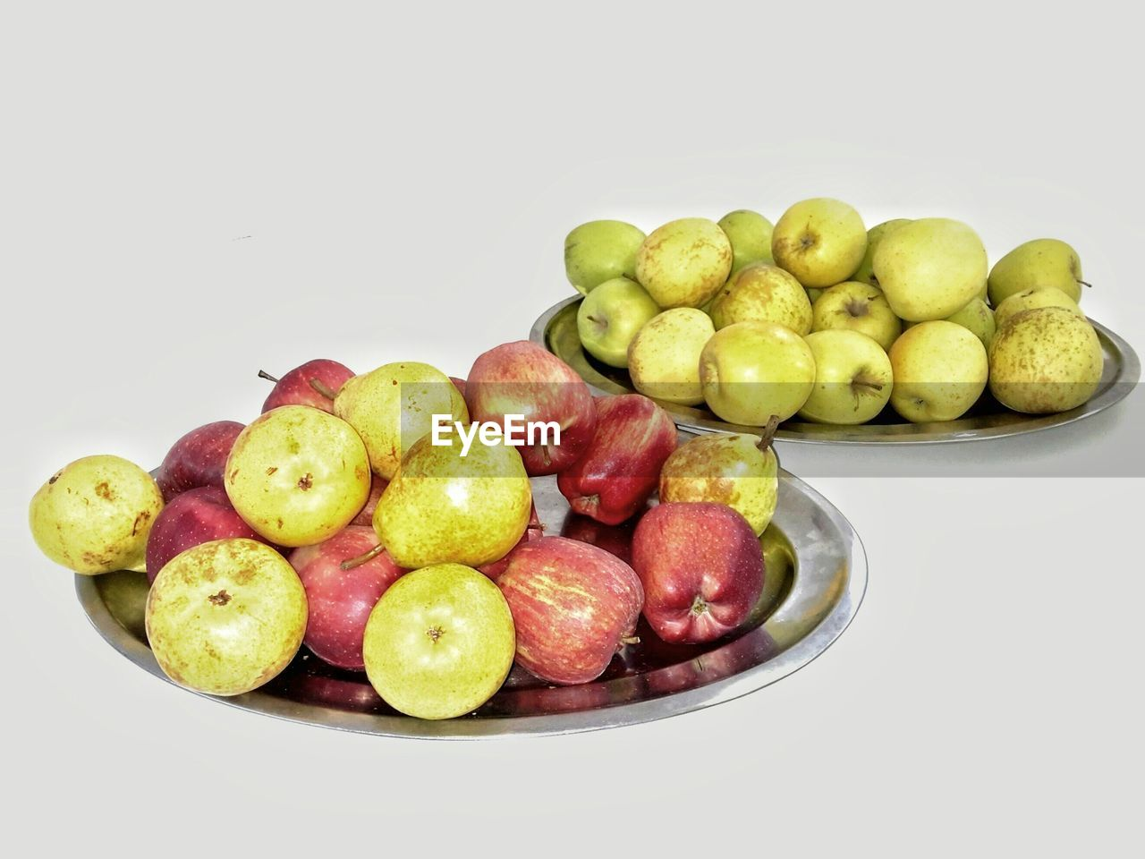 Fresh Pears And Apples On Plate Against White Background