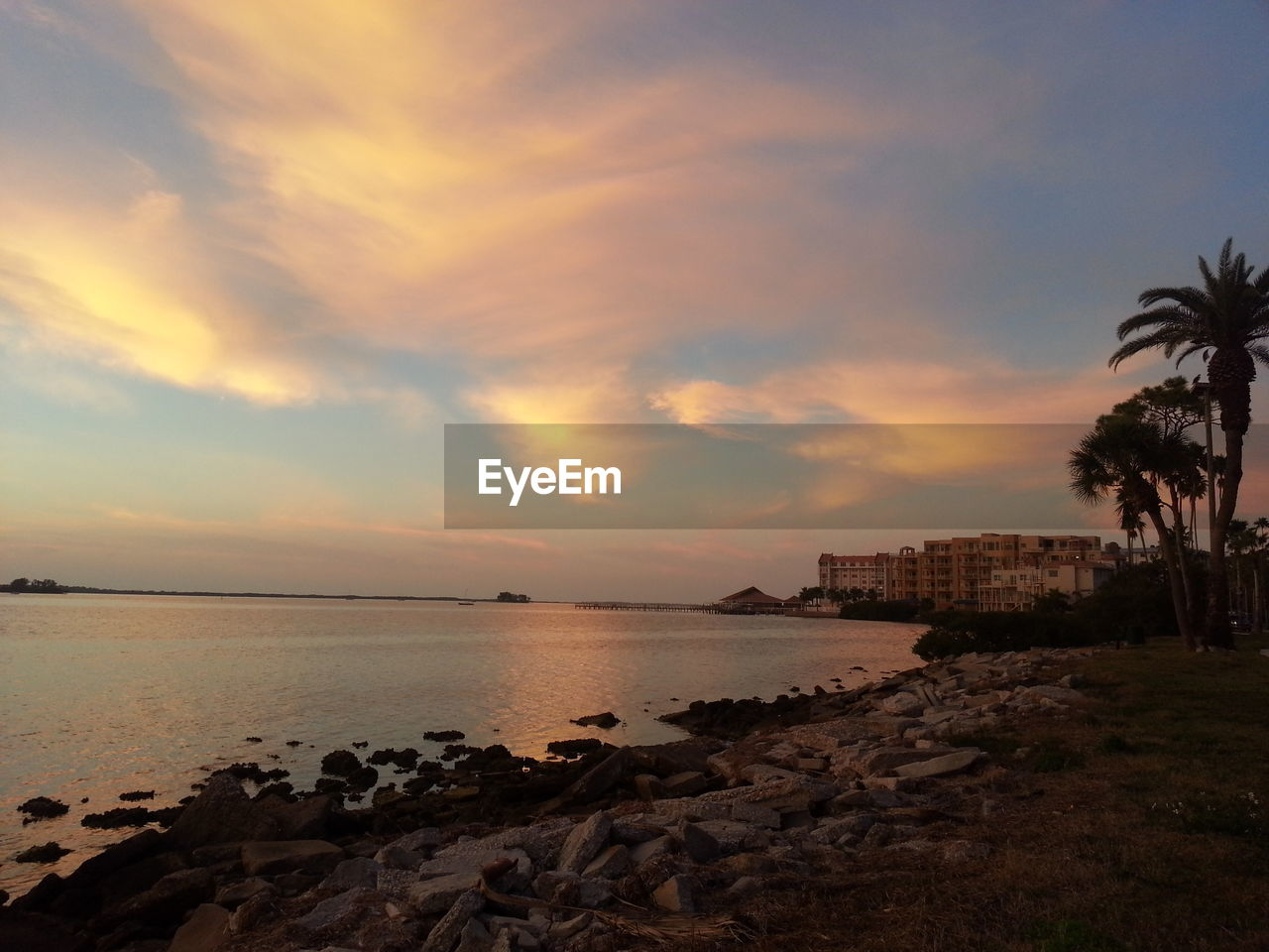 Scenic View Of Sea At Sunset Against Sky