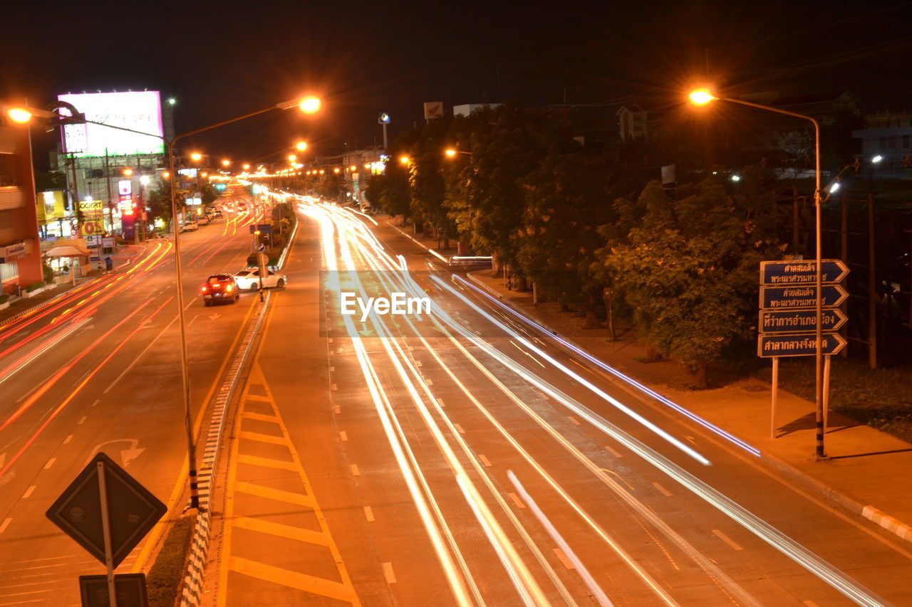 illuminated, night, road, city, street, sign, transportation, architecture, motion, street light, light trail, long exposure, symbol, building exterior, city life, lighting equipment, speed, built structure, direction, no people, city street, outdoors, cityscape, light