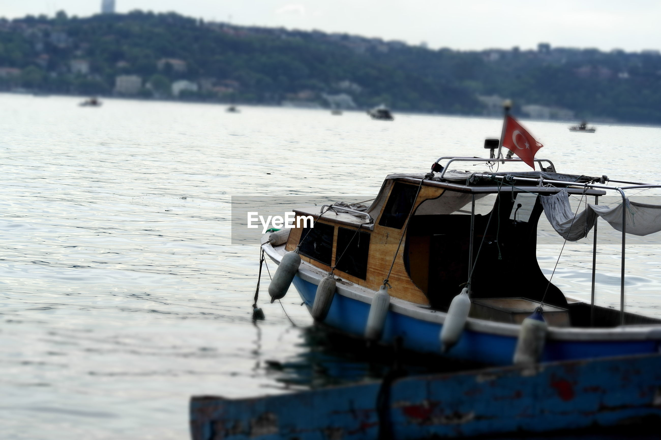 water, nautical vessel, transportation, mode of transport, boat, men, focus on foreground, river, sea, lake, sitting, lifestyles, moored, leisure activity, side view, nature, day, outdoors