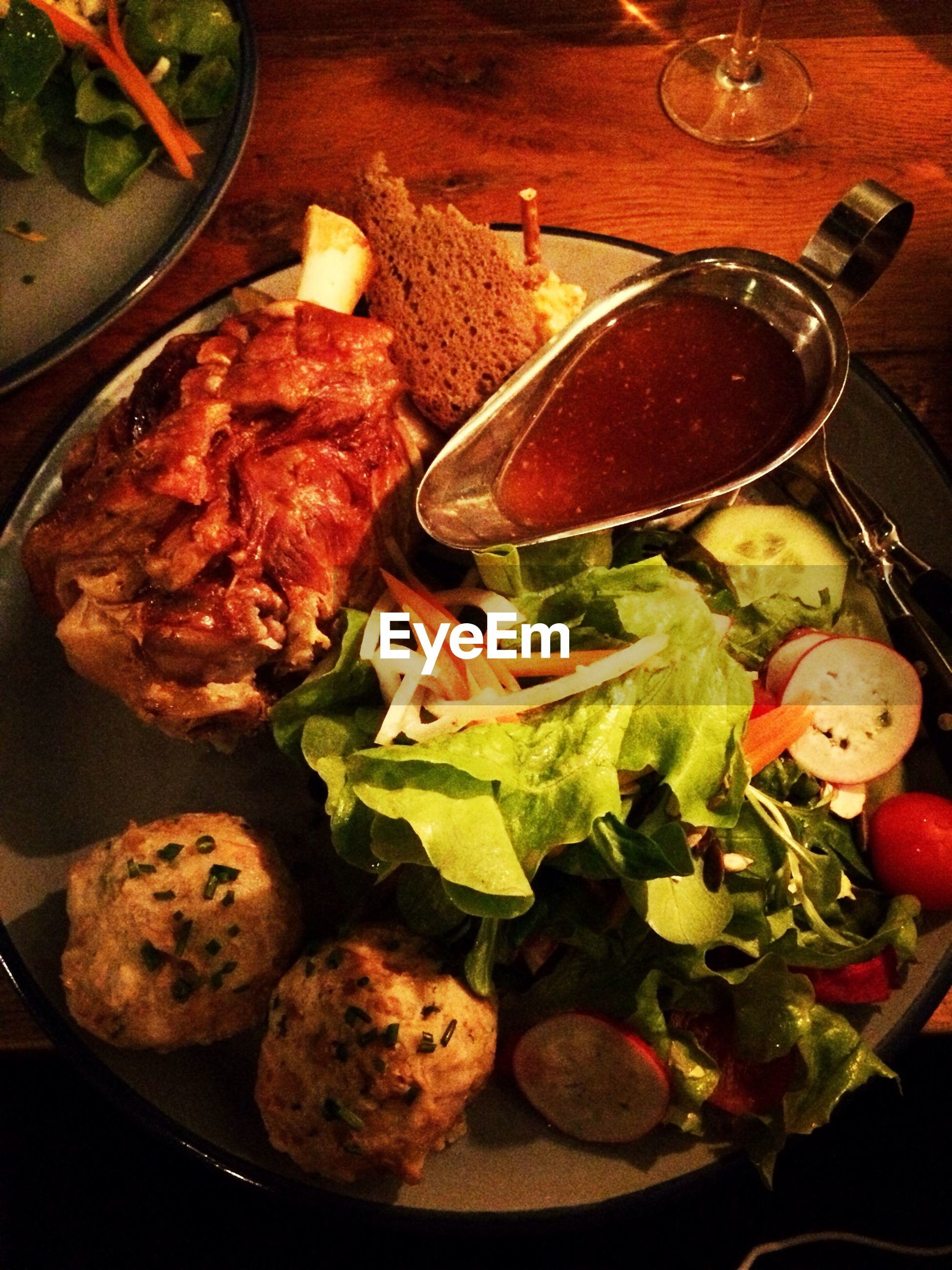 High angle view of meat with salad served in plate on table