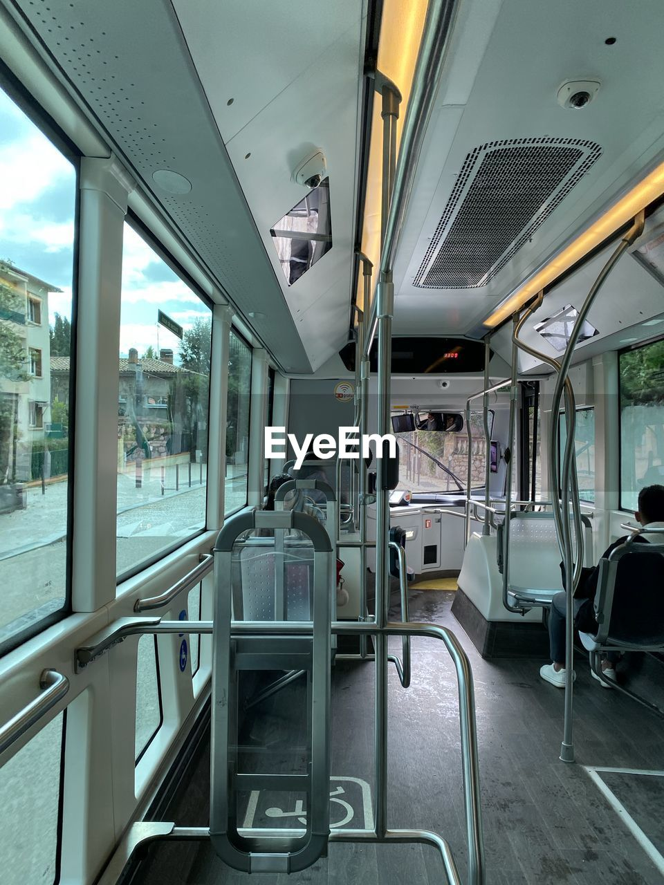 vehicle interior, mode of transportation, public transportation, transportation, vehicle seat, rail transportation, seat, train, empty, train - vehicle, glass - material, window, travel, land vehicle, day, train interior, bus, transparent, no people, absence, outdoors