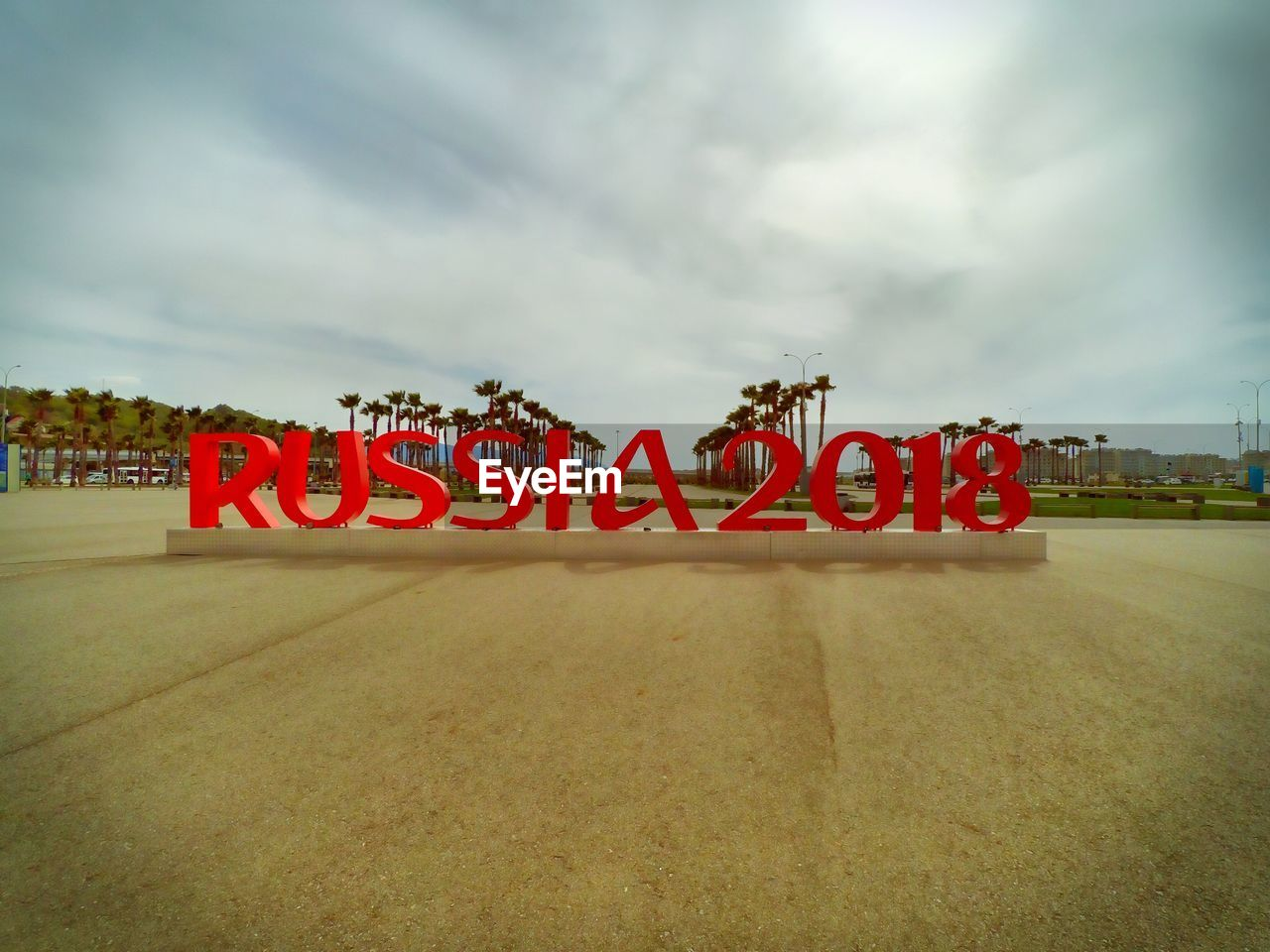 text, cloud - sky, sky, western script, communication, red, no people, nature, sign, capital letter, day, sport, outdoors, single word, information, road, arts culture and entertainment, transportation, celebration, direction