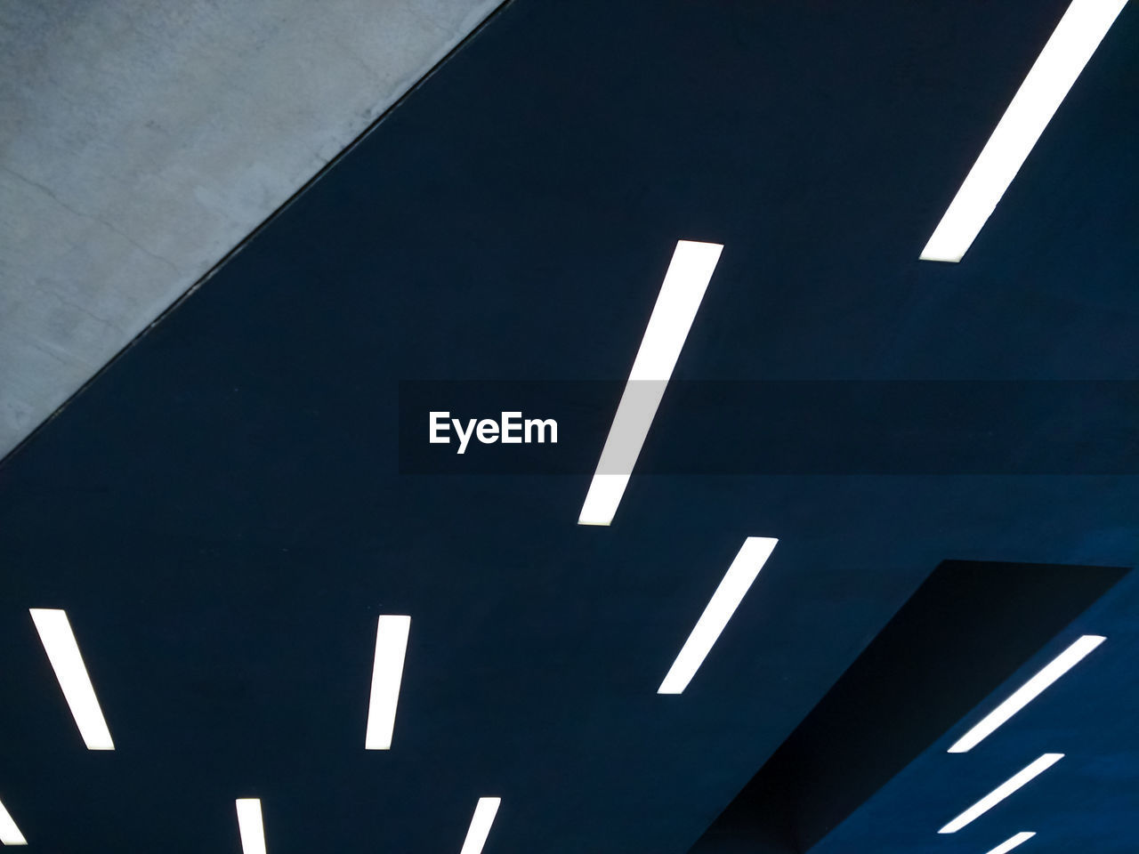 Low Angle View Of Modern Lights