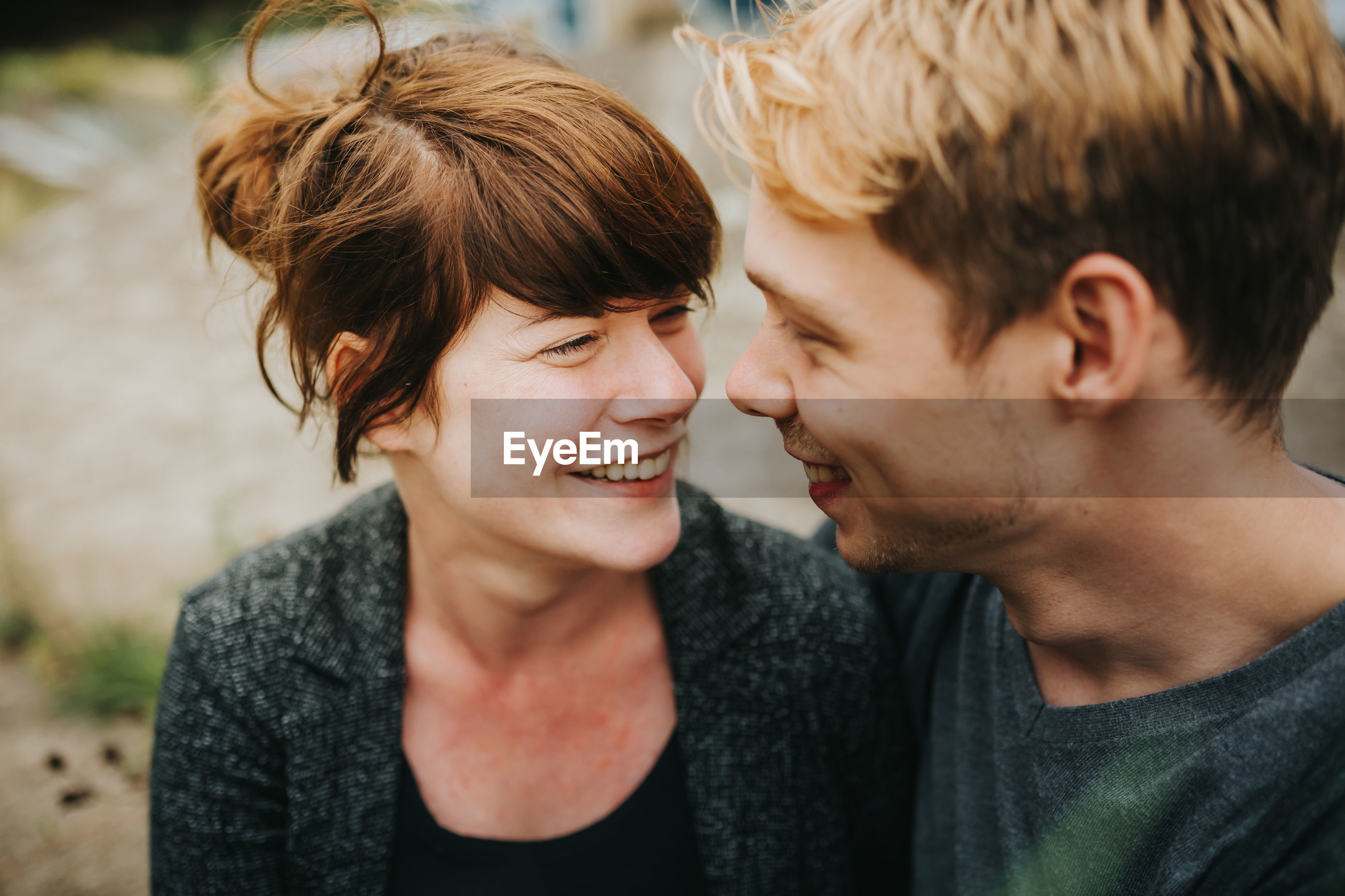 Smiling couple embracing on land