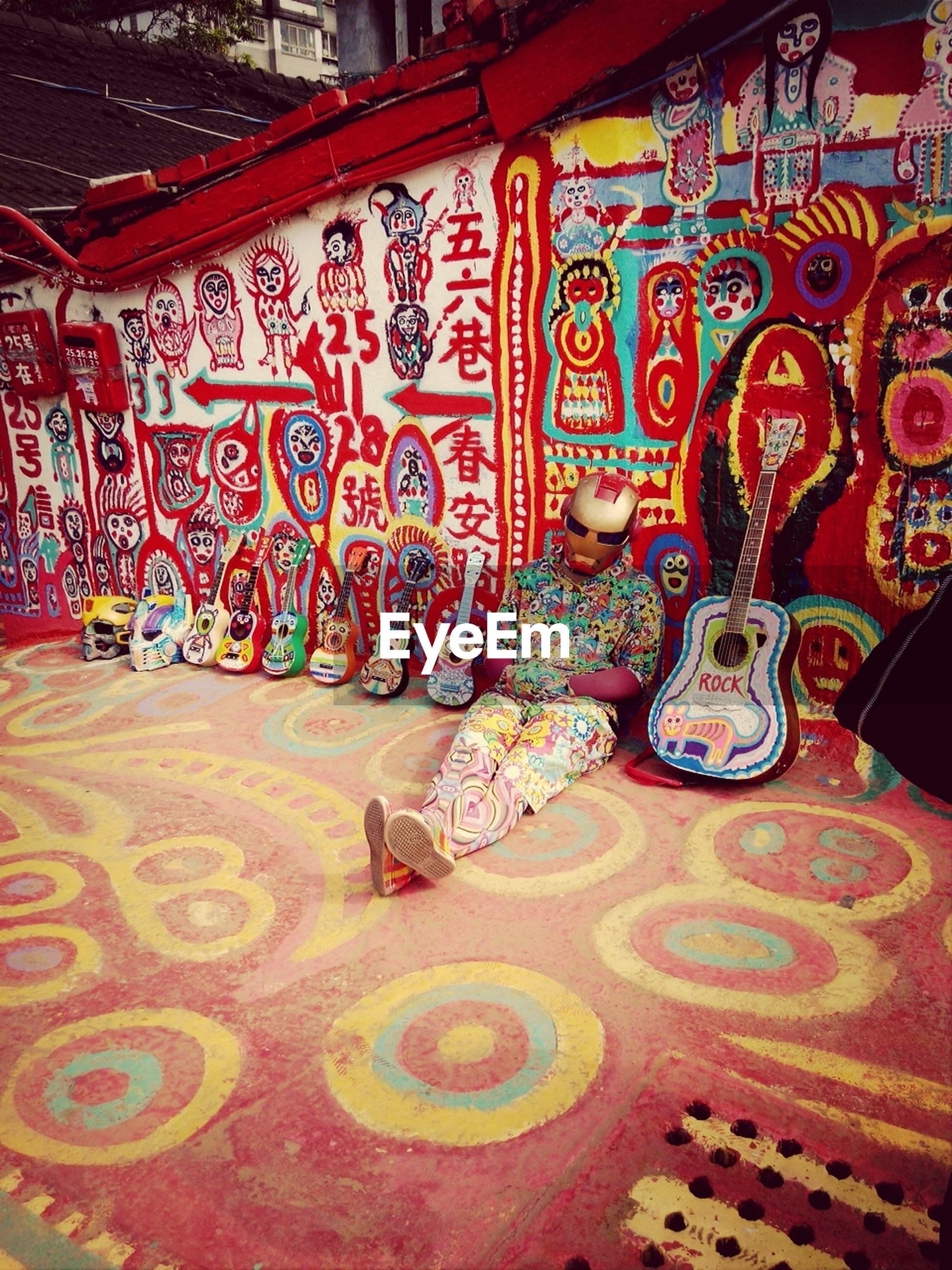 indoors, art and craft, art, creativity, design, multi colored, pattern, floral pattern, ornate, decoration, no people, tradition, red, wall - building feature, animal representation, human representation, built structure, architecture, variation, cultures