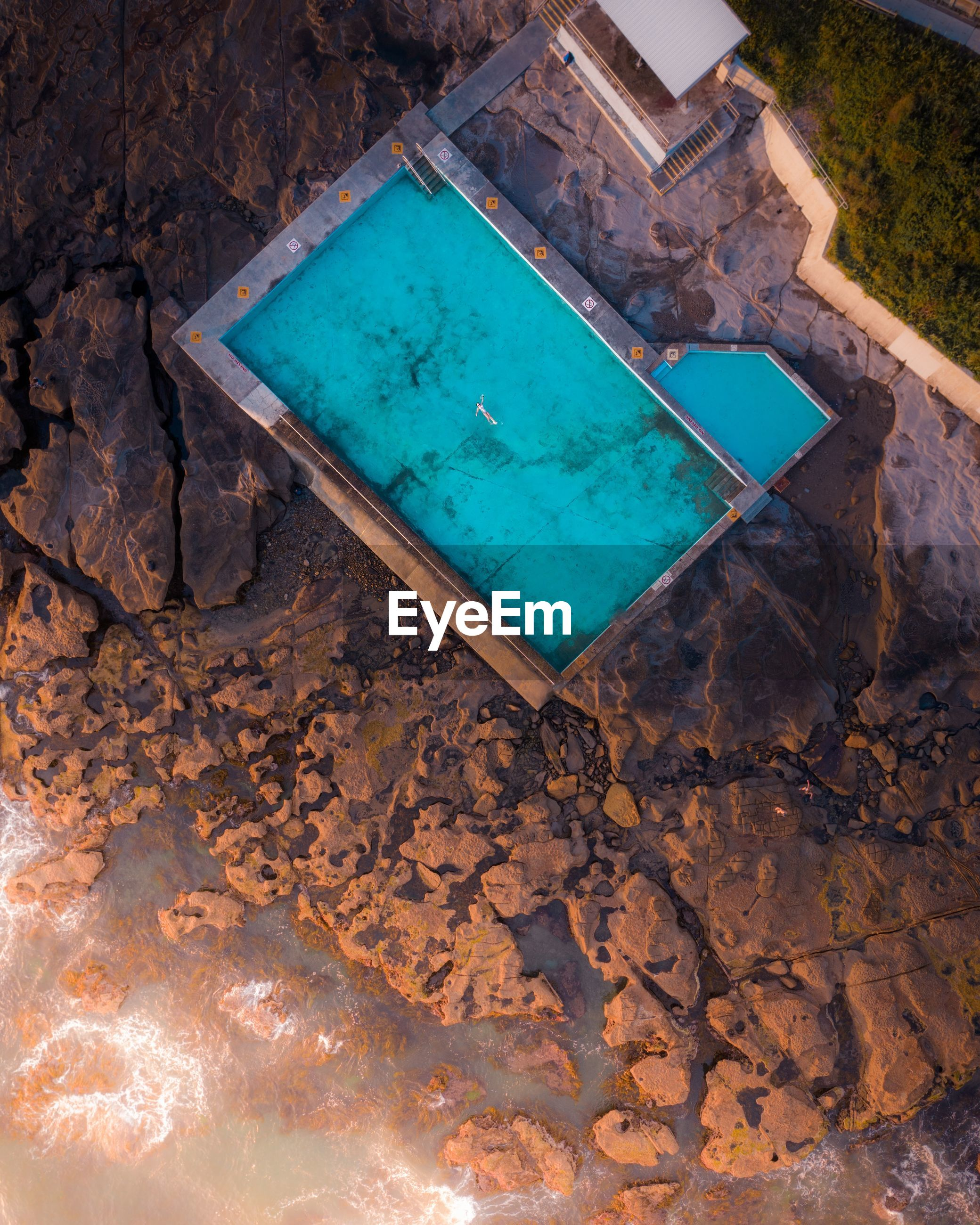 HIGH ANGLE VIEW OF SWIMMING POOL IN A WATER