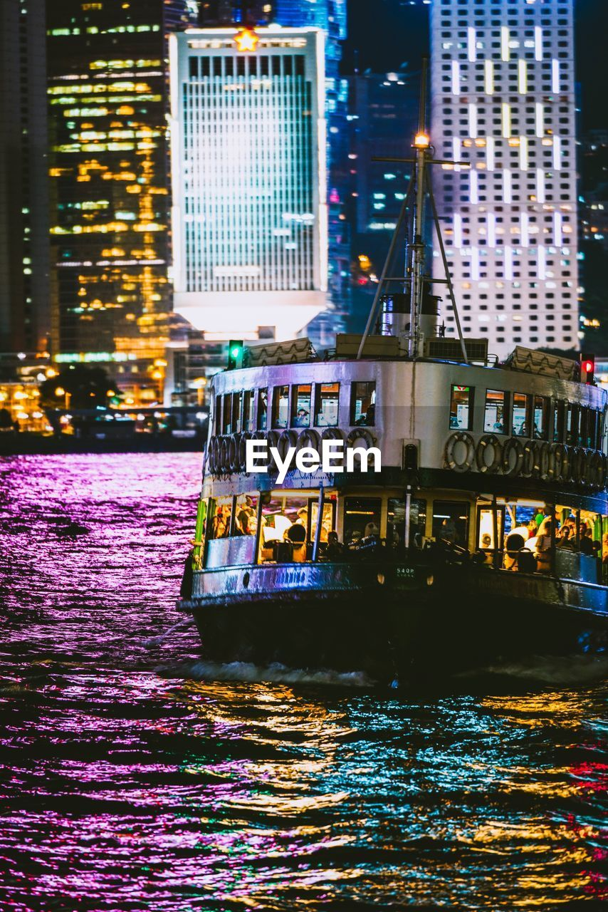 illuminated, water, building exterior, architecture, built structure, nautical vessel, city, transportation, waterfront, night, mode of transportation, building, no people, river, reflection, nature, outdoors, houseboat, office building exterior, skyscraper, passenger craft, financial district