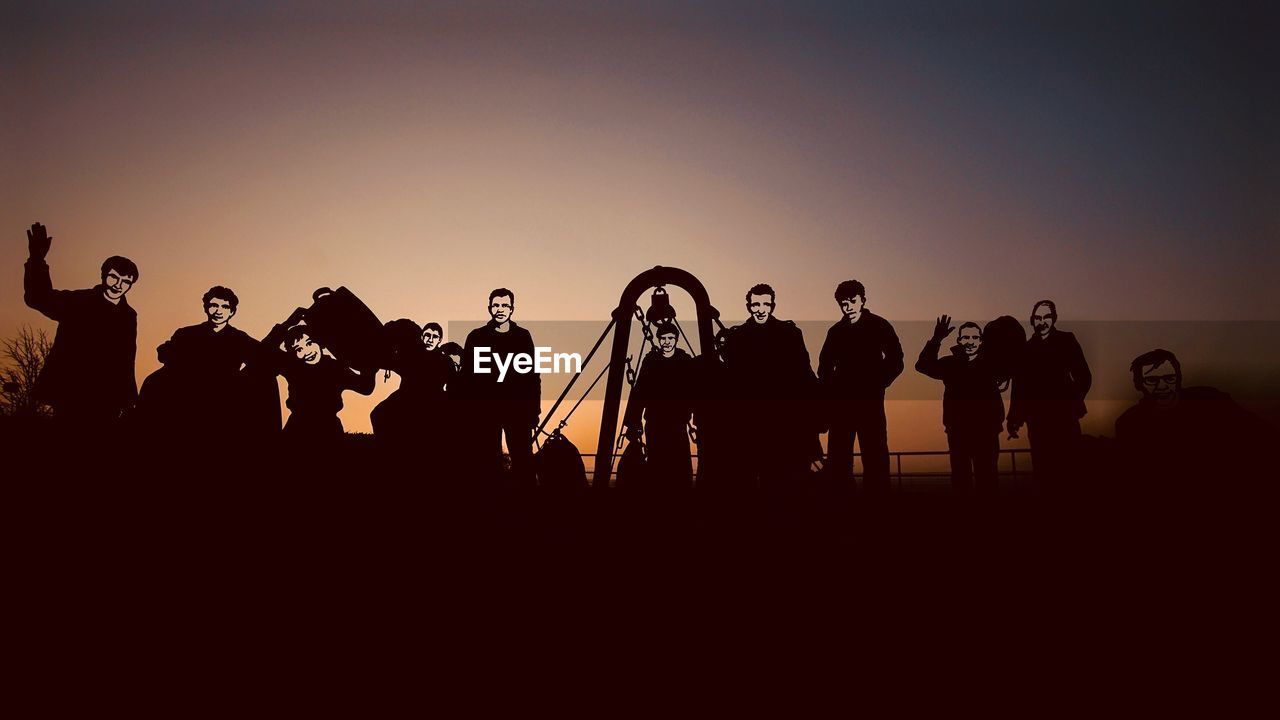 group of people, sky, real people, men, crowd, sunset, copy space, large group of people, leisure activity, lifestyles, clear sky, nature, women, silhouette, standing, togetherness, orange color, adult, outdoors