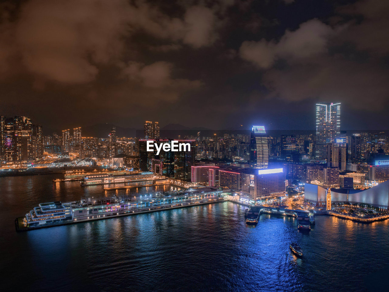 architecture, city, building exterior, built structure, water, illuminated, nautical vessel, cloud - sky, cityscape, sky, night, transportation, waterfront, building, river, no people, nature, office building exterior, urban skyline, skyscraper, outdoors, modern