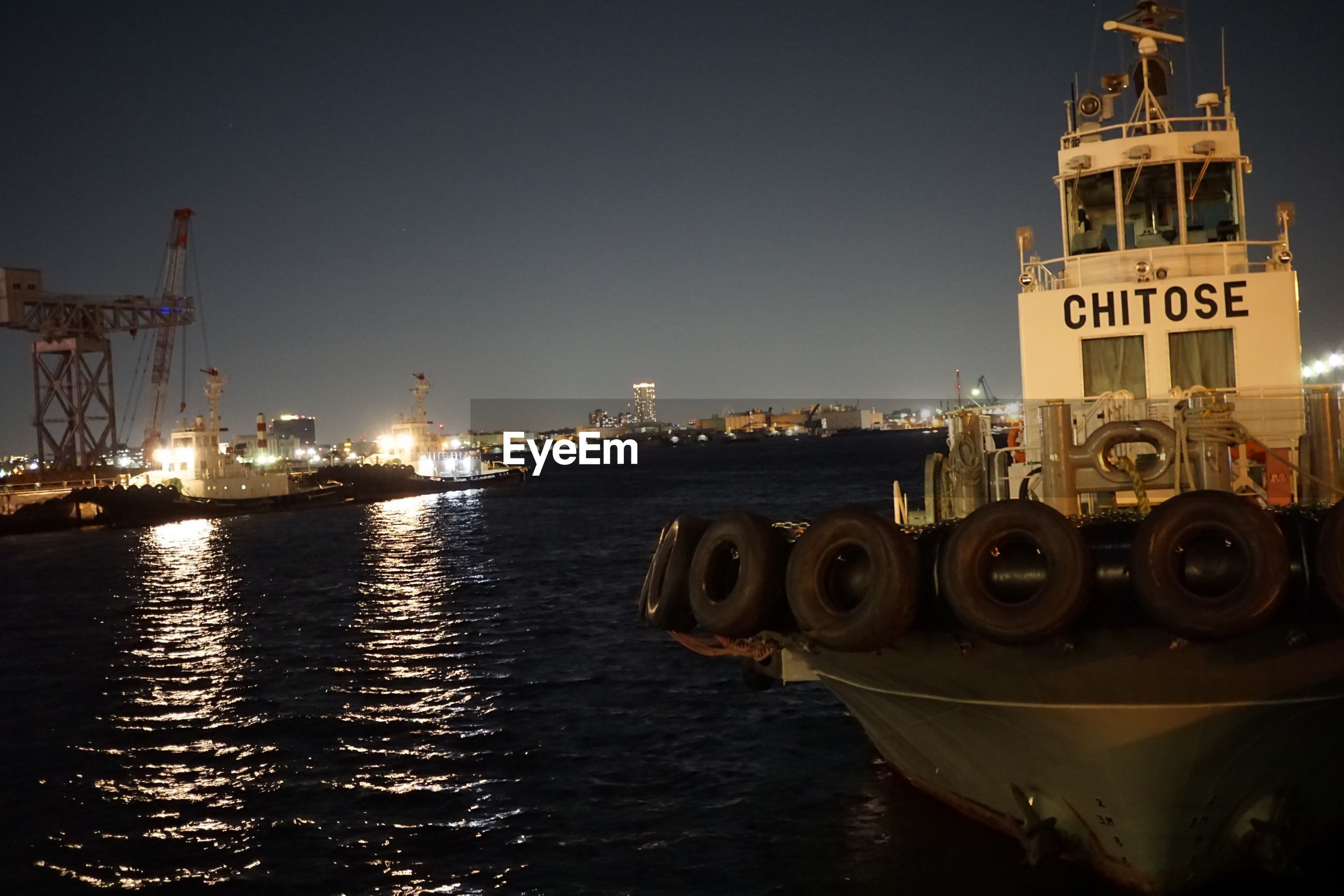 water, sky, building exterior, architecture, built structure, nature, illuminated, no people, nautical vessel, clear sky, copy space, waterfront, transportation, city, night, mode of transportation, text, outdoors, river, passenger craft
