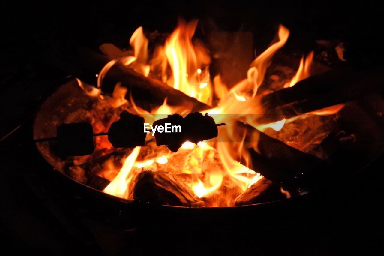 heat - temperature, fire, flame, burning, fire - natural phenomenon, wood, glowing, night, wood - material, orange color, log, close-up, firewood, no people, fire pit, fireplace, motion, nature, bonfire, long exposure, campfire, dark