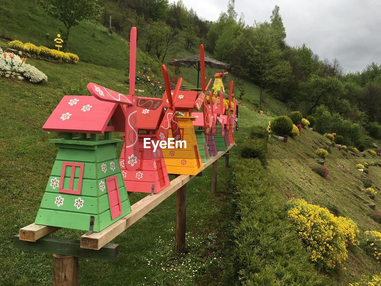 Wooden toy windmills at park
