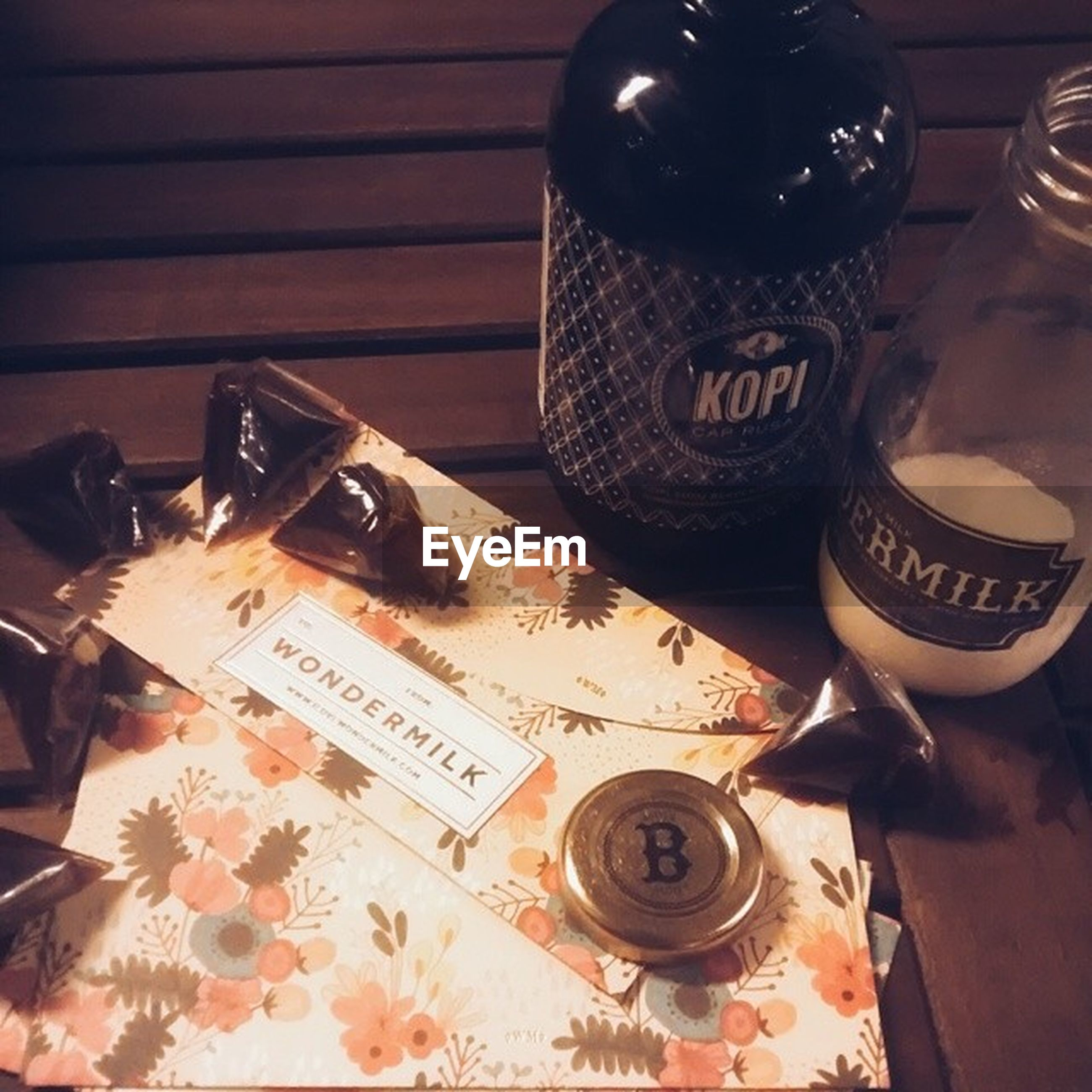 indoors, table, still life, high angle view, food and drink, communication, text, close-up, old-fashioned, drink, wood - material, technology, retro styled, antique, coffee cup, no people, home interior, western script, old, coffee - drink