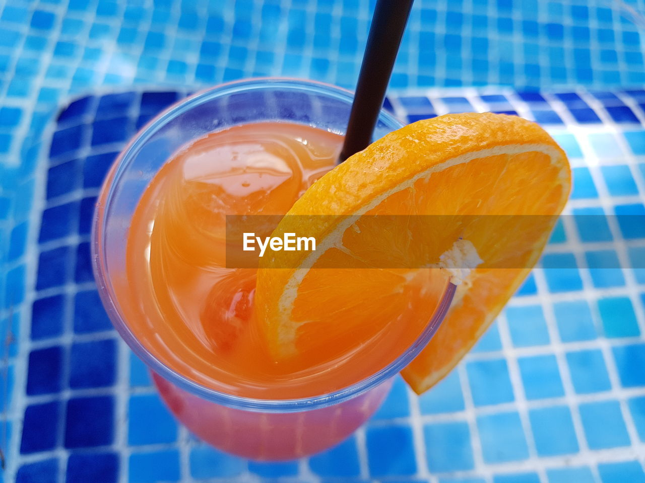 food and drink, food, healthy eating, fruit, wellbeing, freshness, drink, glass, refreshment, orange color, drinking straw, high angle view, still life, close-up, slice, straw, orange - fruit, no people, drinking glass, citrus fruit, orange, swimming pool