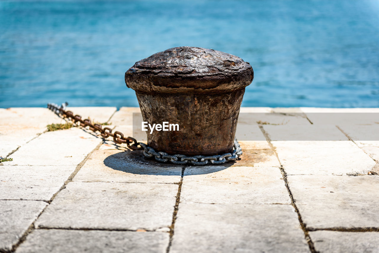 Chain on cleat at harbor