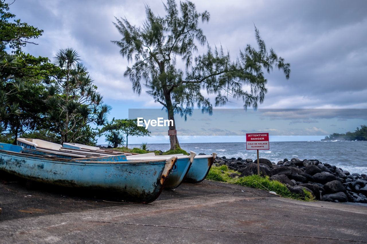 water, sky, cloud - sky, tree, nautical vessel, plant, transportation, nature, day, mode of transportation, sea, no people, land, beauty in nature, beach, outdoors, moored, tranquility, scenics - nature