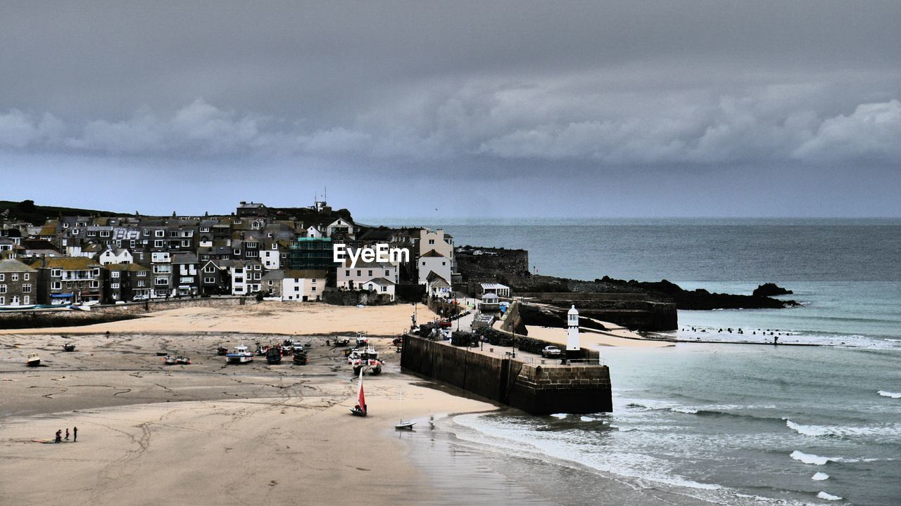 St Ives Town By Sea Against Cloudy Sky