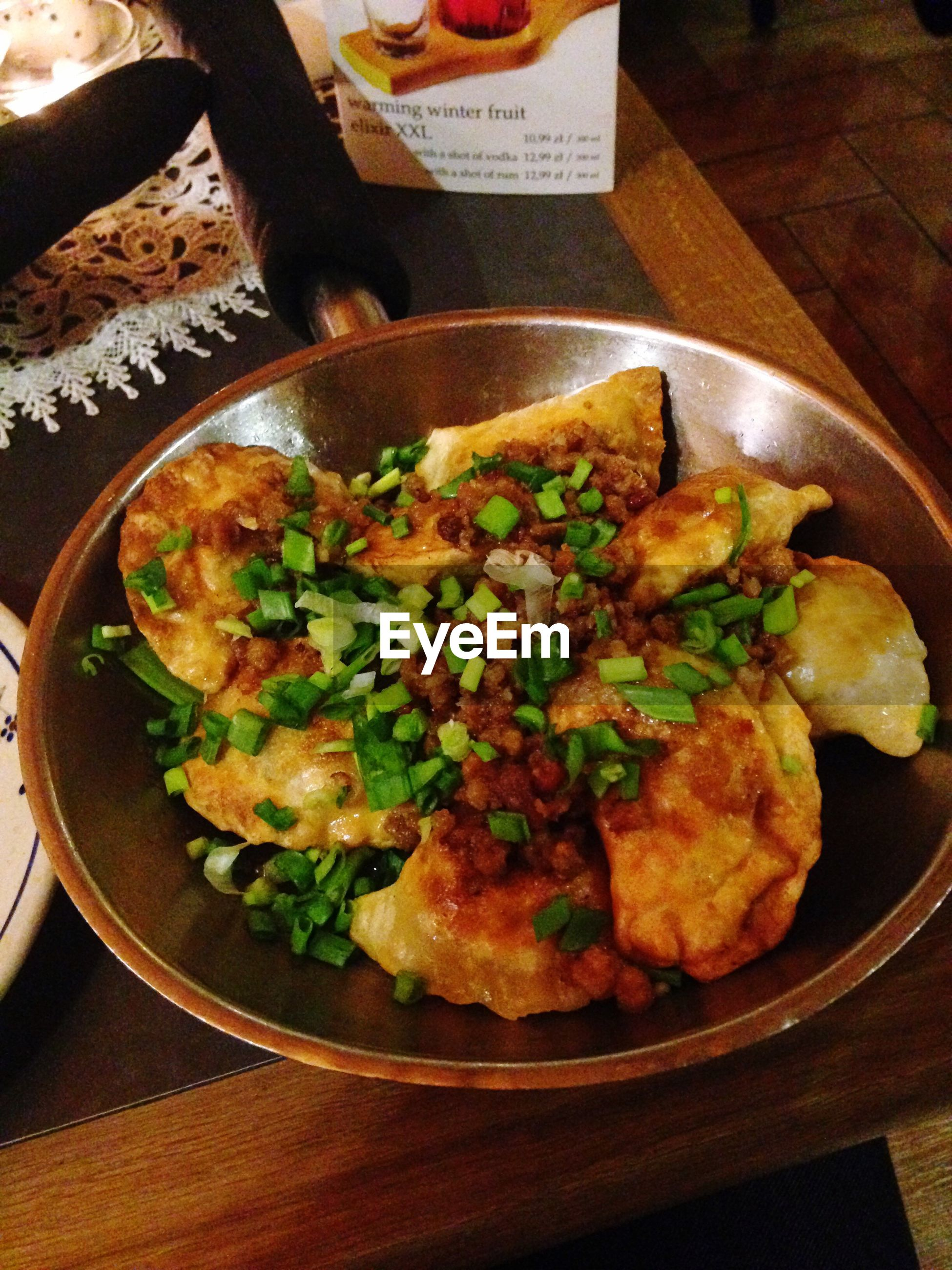 High angle view of fresh pierogi in bowl on table at restaurant