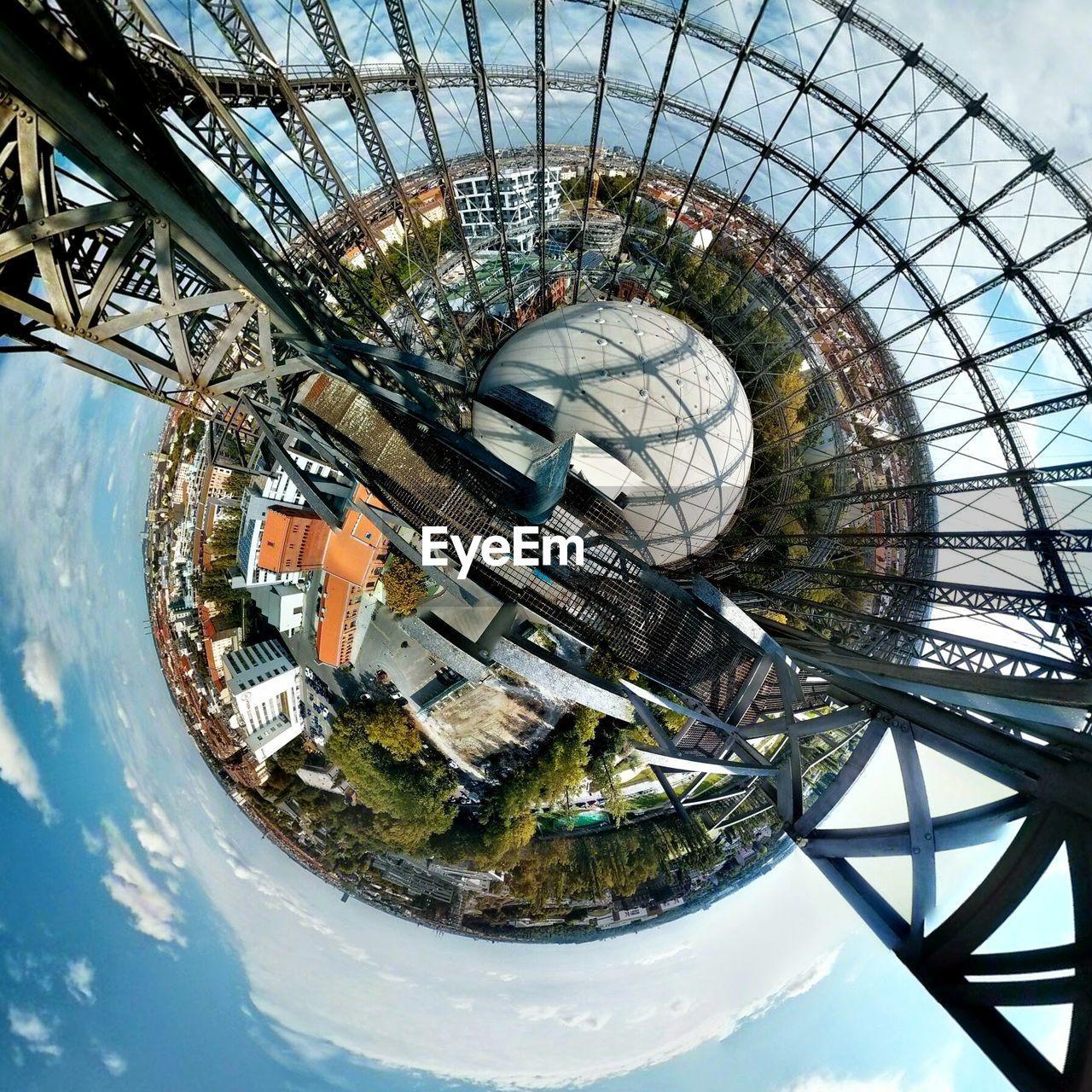 Fish-Eye Lens Of Cityscape Against Sky
