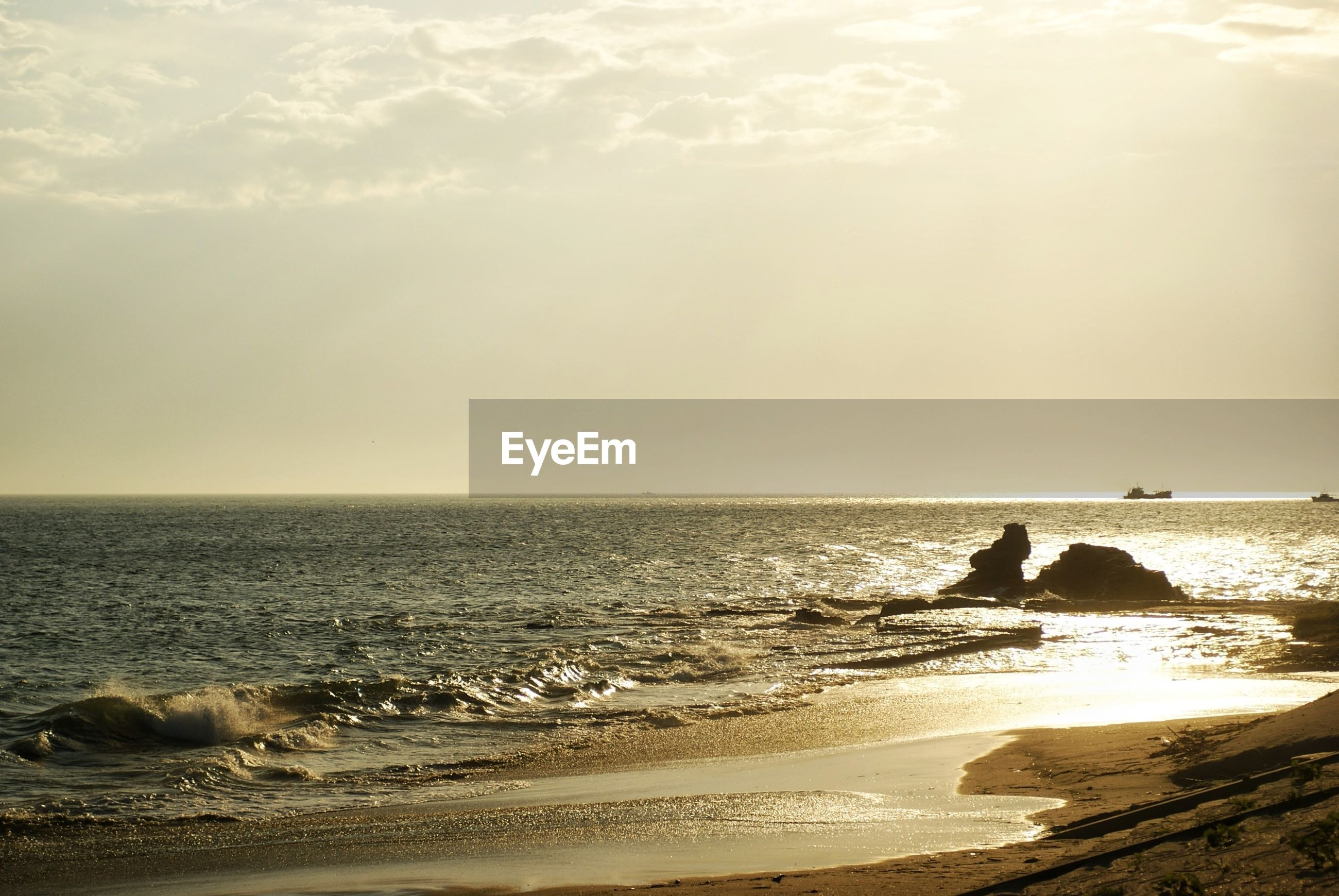 sea, horizon over water, water, beach, scenics, shore, tranquil scene, beauty in nature, sky, tranquility, nature, wave, sunset, idyllic, rock - object, sand, coastline, vacations, incidental people
