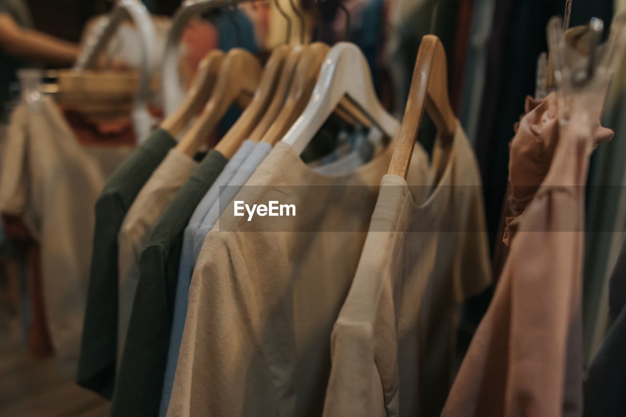 PANORAMIC VIEW OF CLOTHES HANGING ON RACK