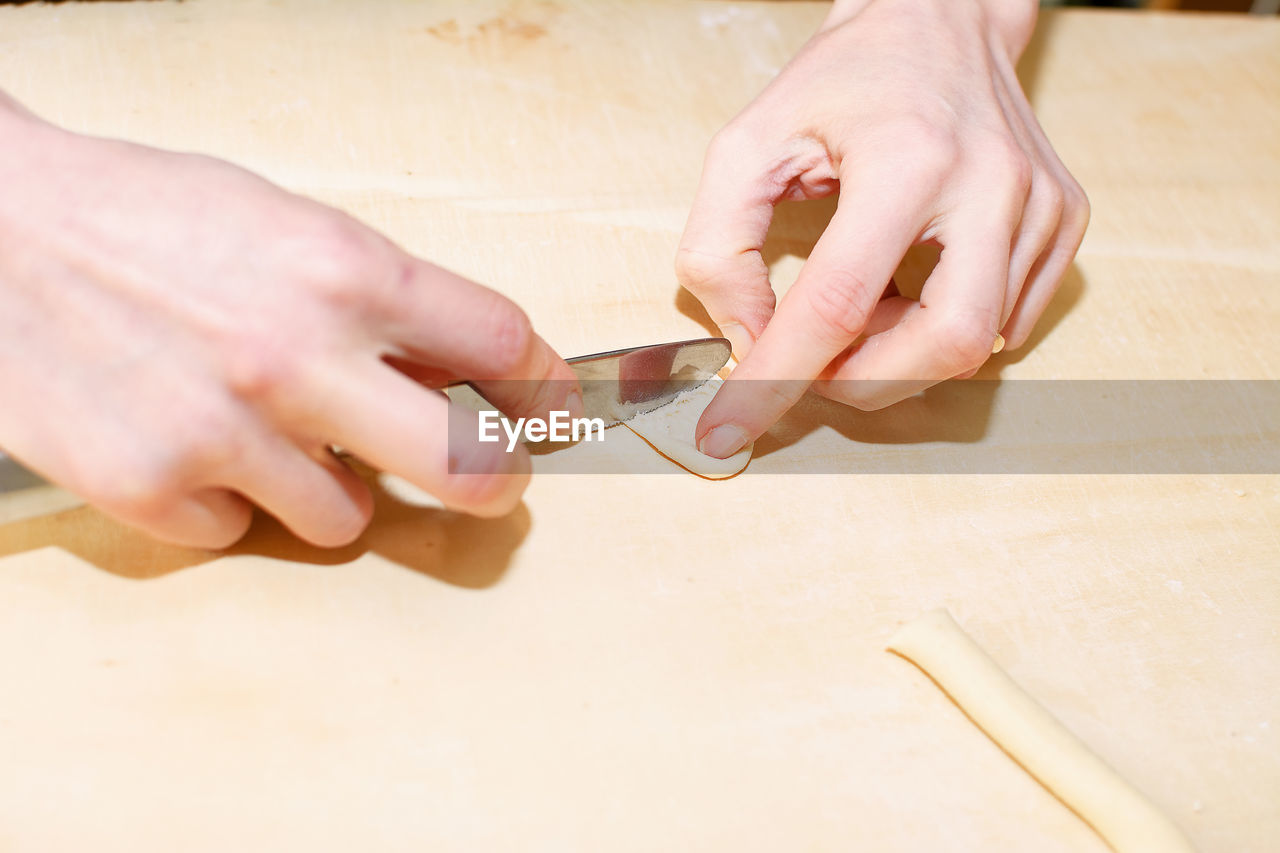 human hand, human body part, wood - material, real people, holding, indoors, table, diy, close-up, workshop, day, men, working