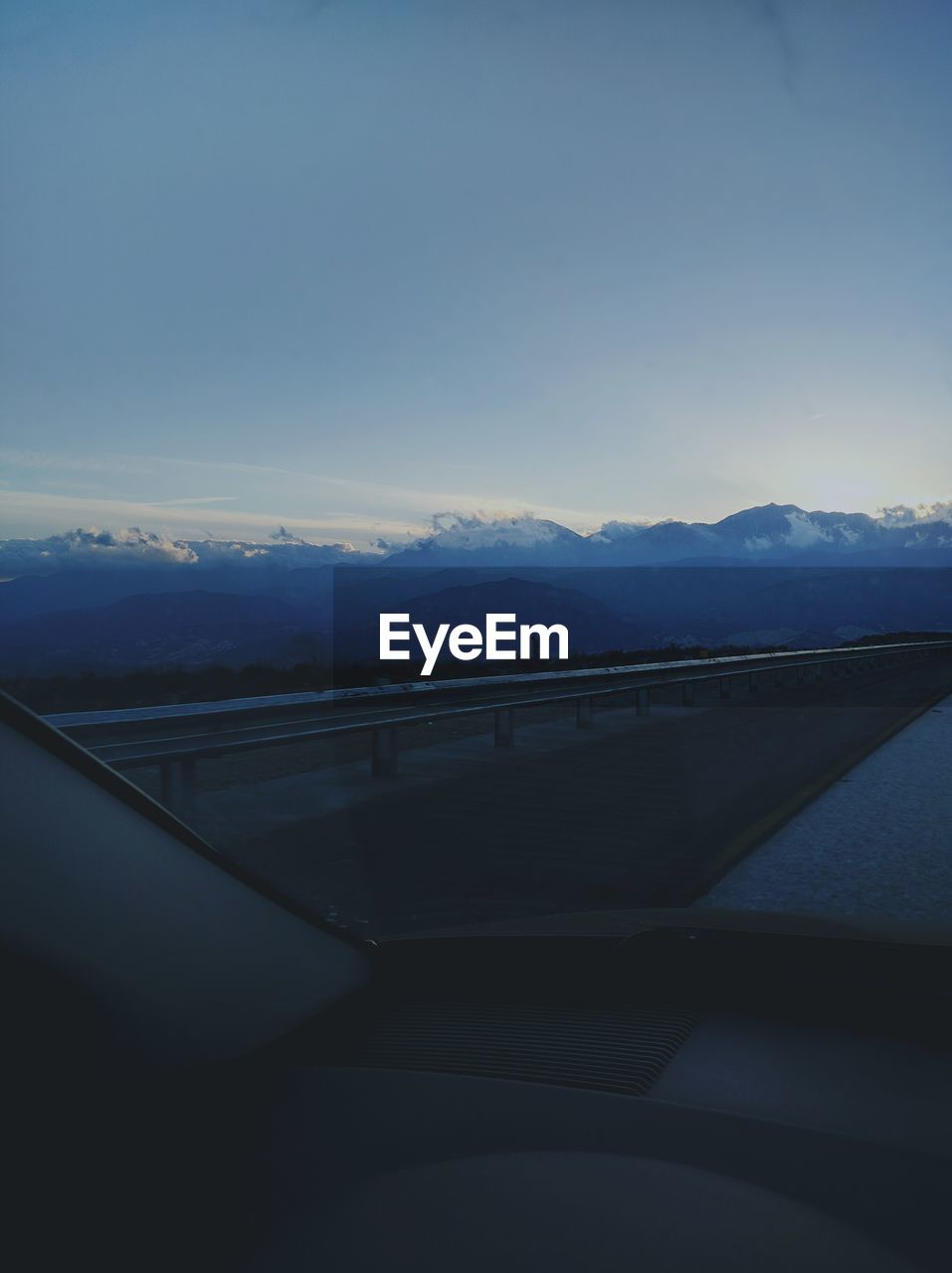 Scenic view of mountain against sky seen through car windshield