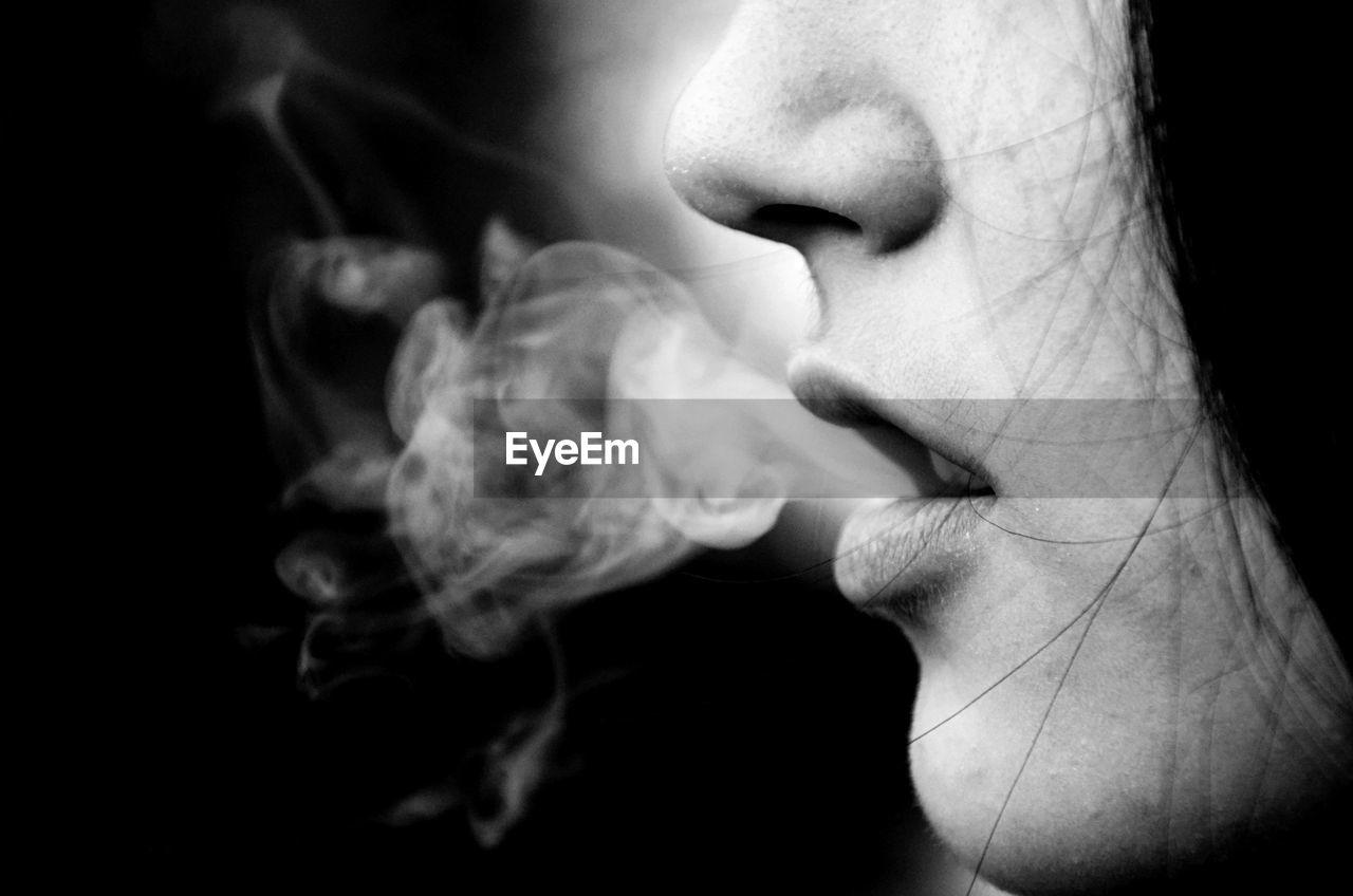Cropped Image Of Woman Smoking