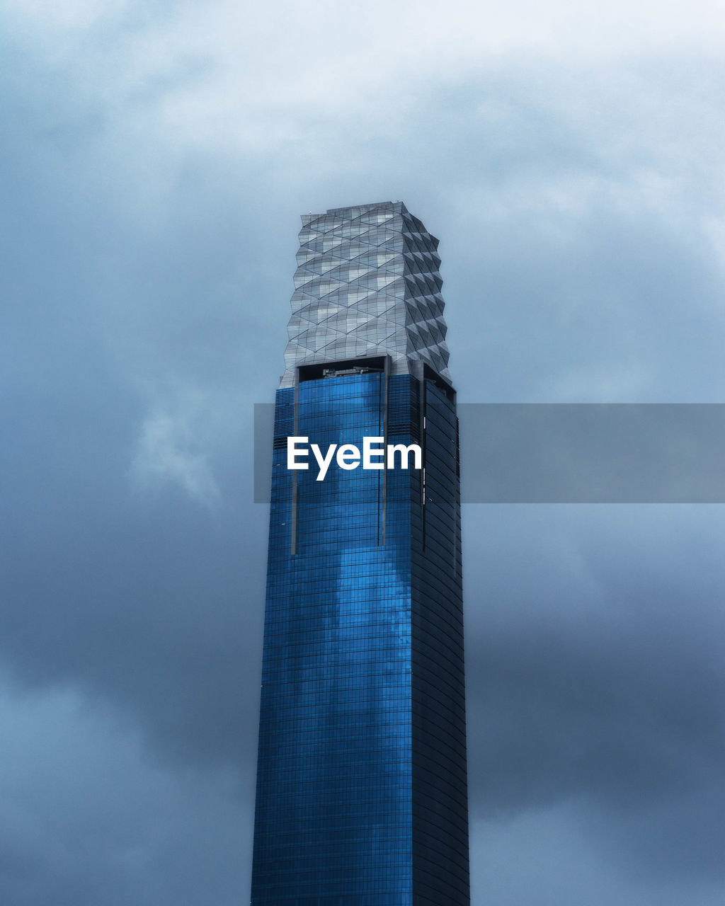 cloud - sky, architecture, built structure, sky, building exterior, tall - high, building, modern, low angle view, nature, office building exterior, tower, skyscraper, day, city, no people, office, outdoors, overcast, financial district